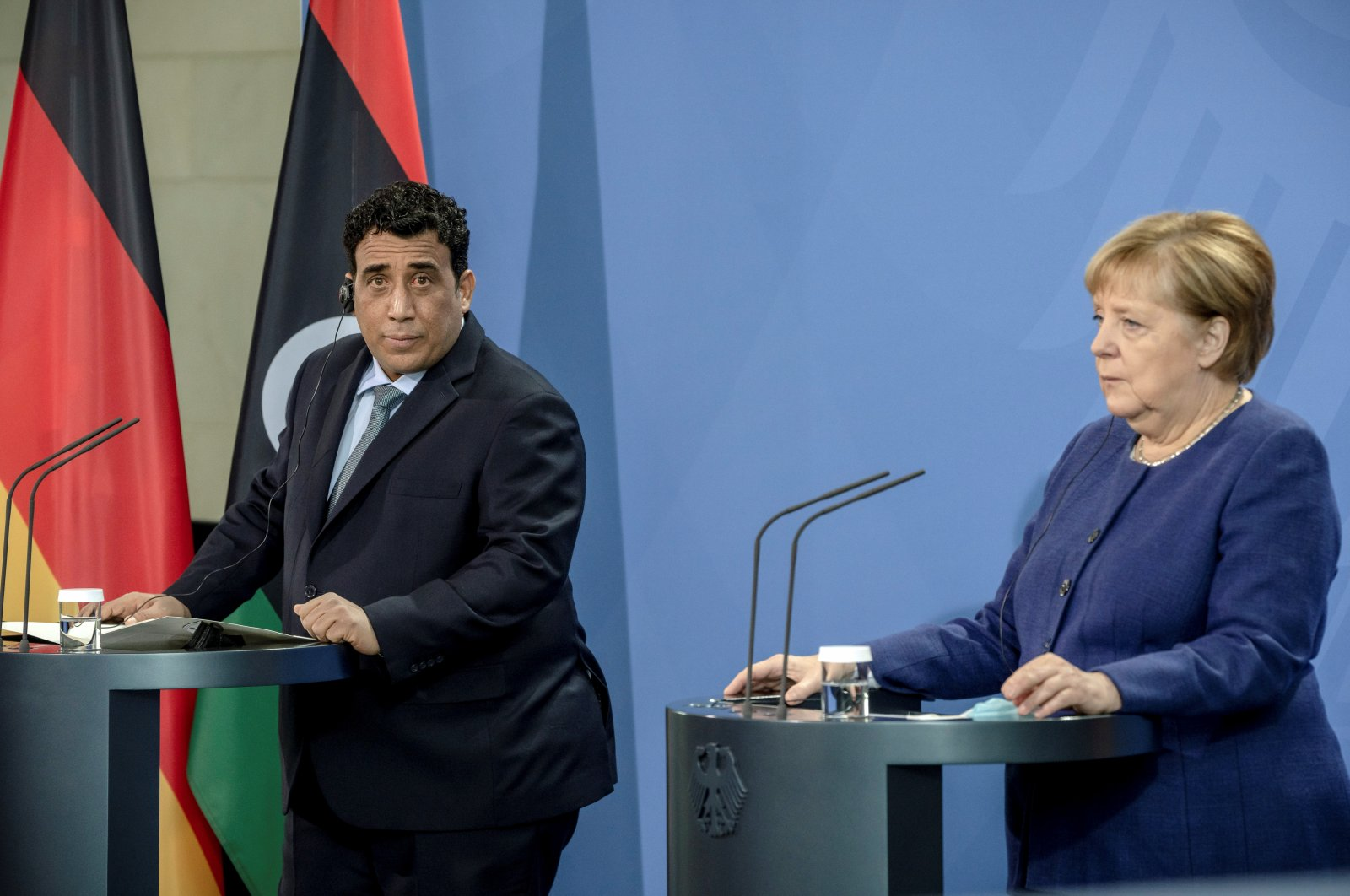 Germany's Chancellor Angela Merkel and president of the Libyan Presidential Council Mohamed Yunus al-Menfi give a joint statement in Berlin, Germany, Oct. 1, 2021. (Reuters Photo)