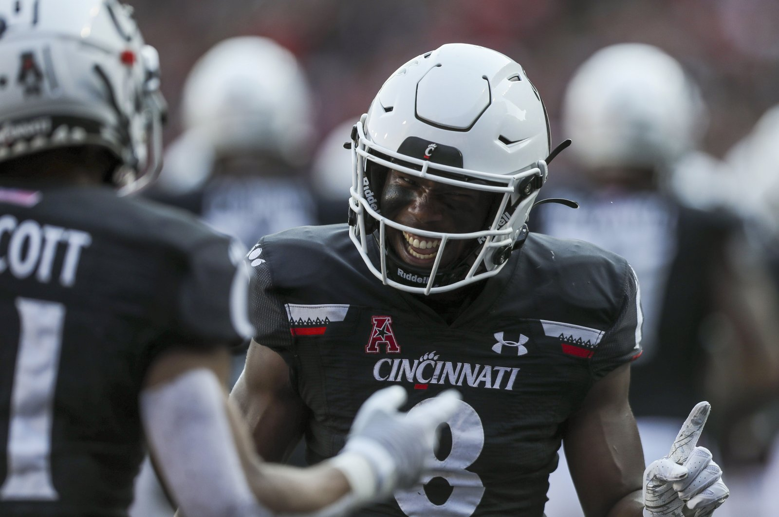 Cincinnati Bearcats wide receiver Michael Young Jr. (8) celebrates with wide receiver Tyler Scott (21) after a touchdown against the Murray State Racers in the second half at Nippert Stadium, Cincinnati, Ohio, U.S., Sept. 11, 2021. (Katie Stratman-USA TODAY Sports via REUTERS)