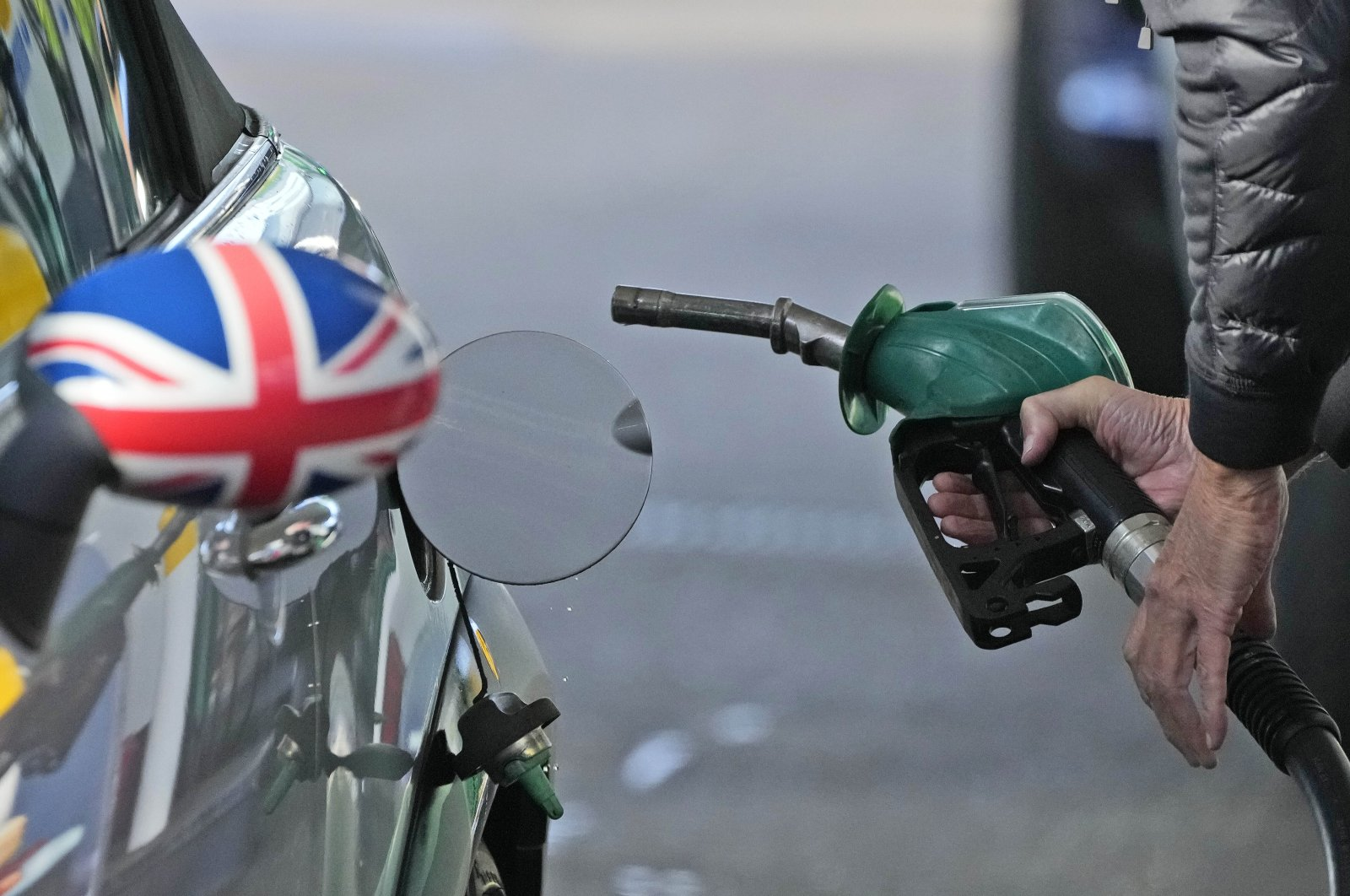 A driver fills a car with fuel at a gas station in London, Sept. 29, 2021. (AP Photo)