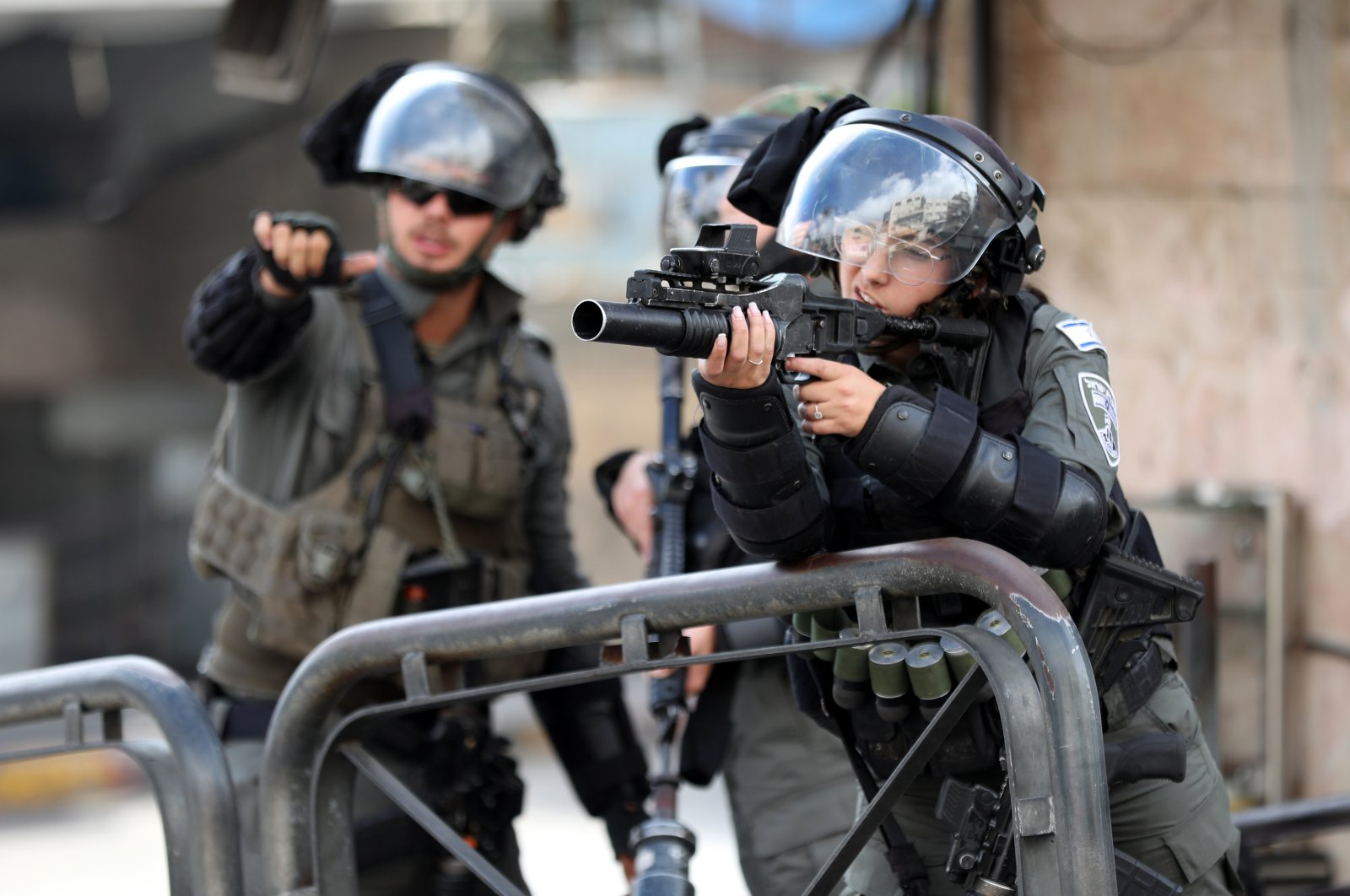 Israeli troops take aim during a Palestinian protest in the city center of Hebron, occupied West Bank, Sept. 10, 2021. (EPA Photo)