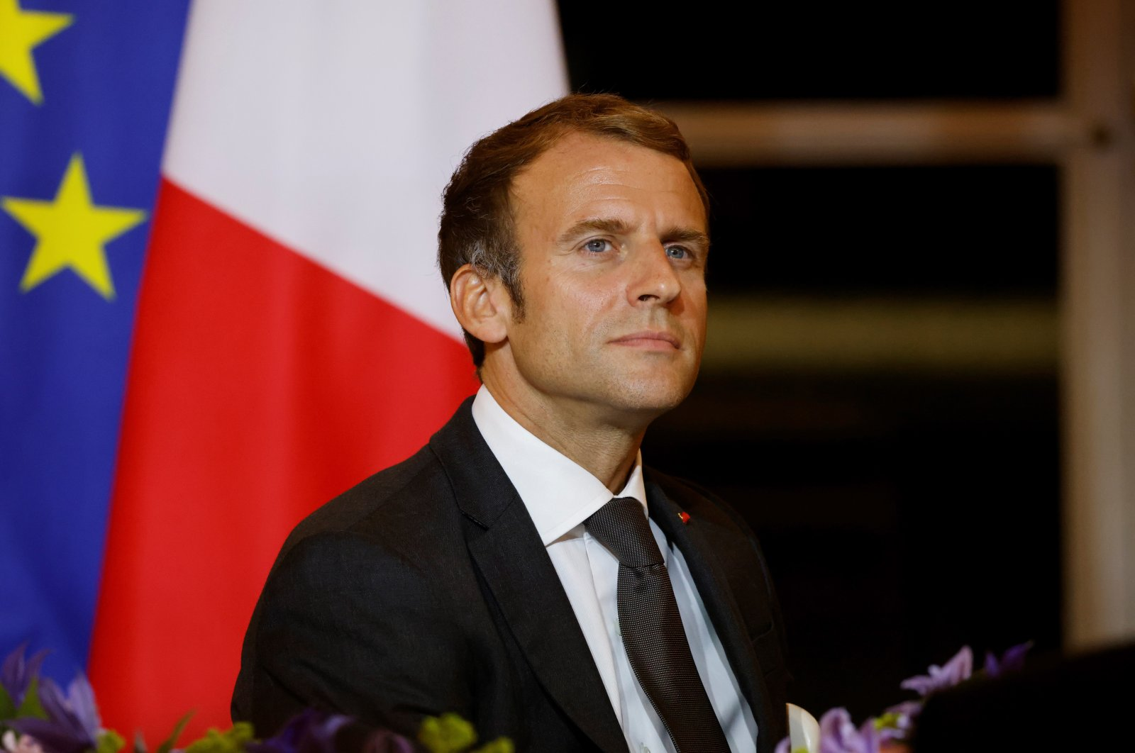 French President Emmanuel Macron reacts as he hosts a dinner at the Elysee Palace as part of the closing ceremony of the Africa2020 Season, which presented the views of the civil society from the African continent and its recent diaspora in different sectors of activity in Paris, France, Sept. 30, 2021.