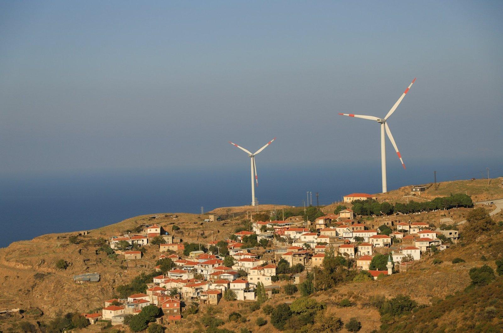 Wind turbines are seen in the Karaburun district of Turkey's Aegean province of Izmir, April 30, 2021. (Shutterstock Photo)