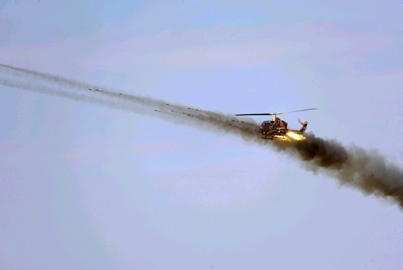 An Iranian army helicopter maneuvers during a military exercise in the northwest of the country, close to the Iranian-Azerbaijani border, Oct. 1, 2021. (AFP Photo)