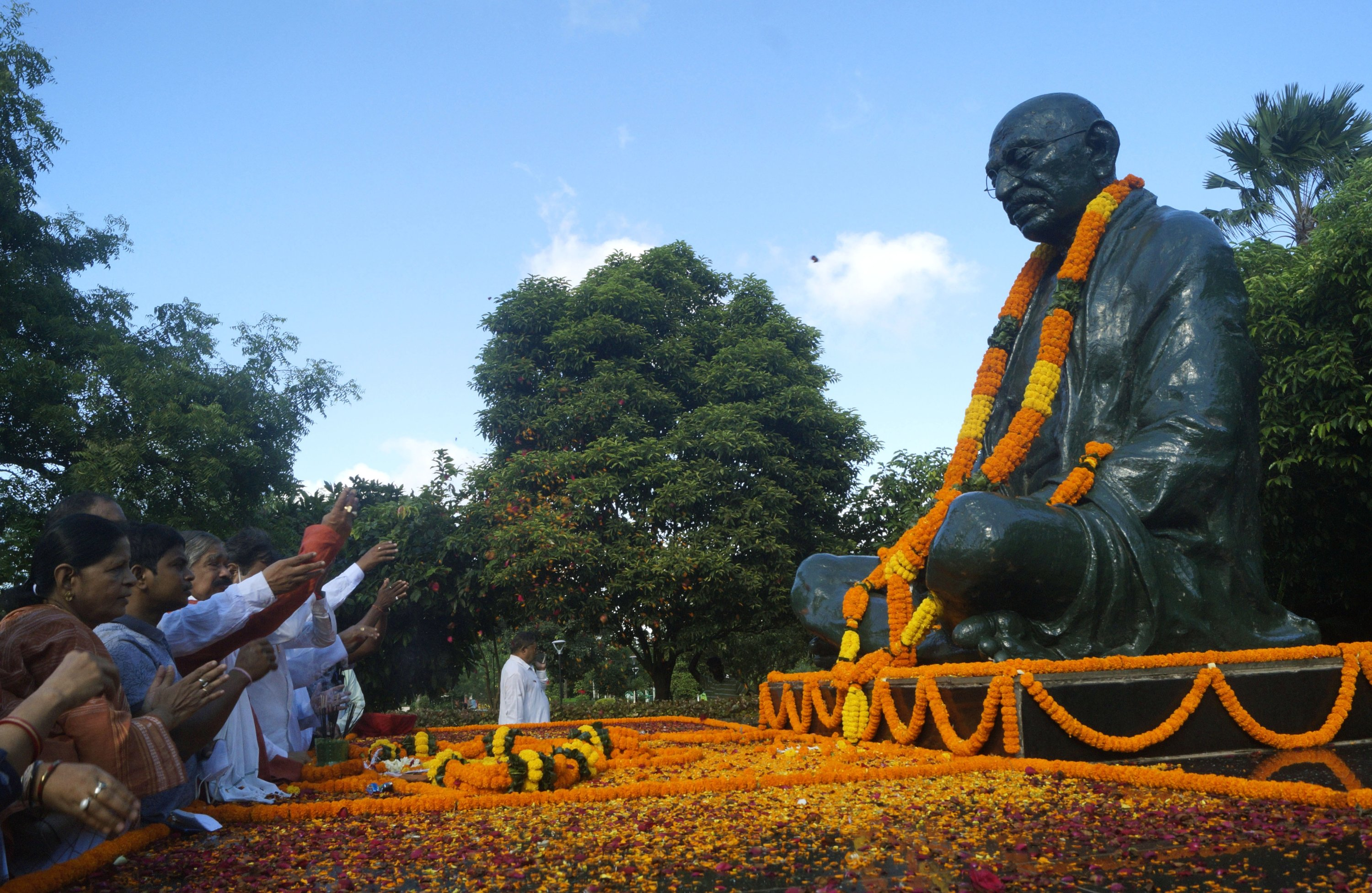 People pay floral tribute to the statue of Mahatma Gandhi at a public park on the occasion of the anniversary of his birth, Bhubaneswar, India, Oct. 2, 2021.  (Photo by STR/NurPhoto via Getty Images)