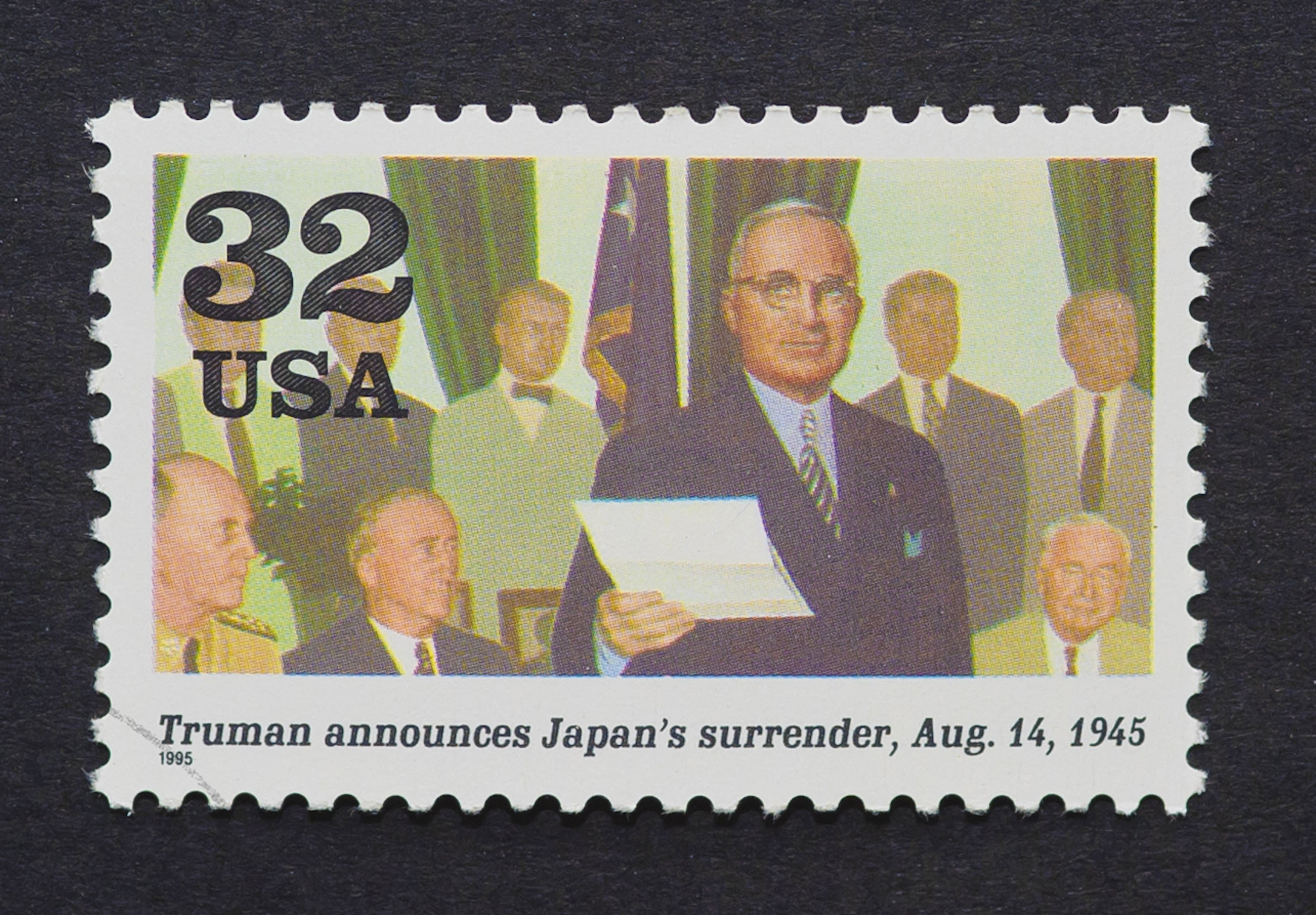 A U.S. postage stamp showing an image of President Harry Truman announcing Japan's surrender in the Second World War, circa 1995. (Shutterstock Photo)