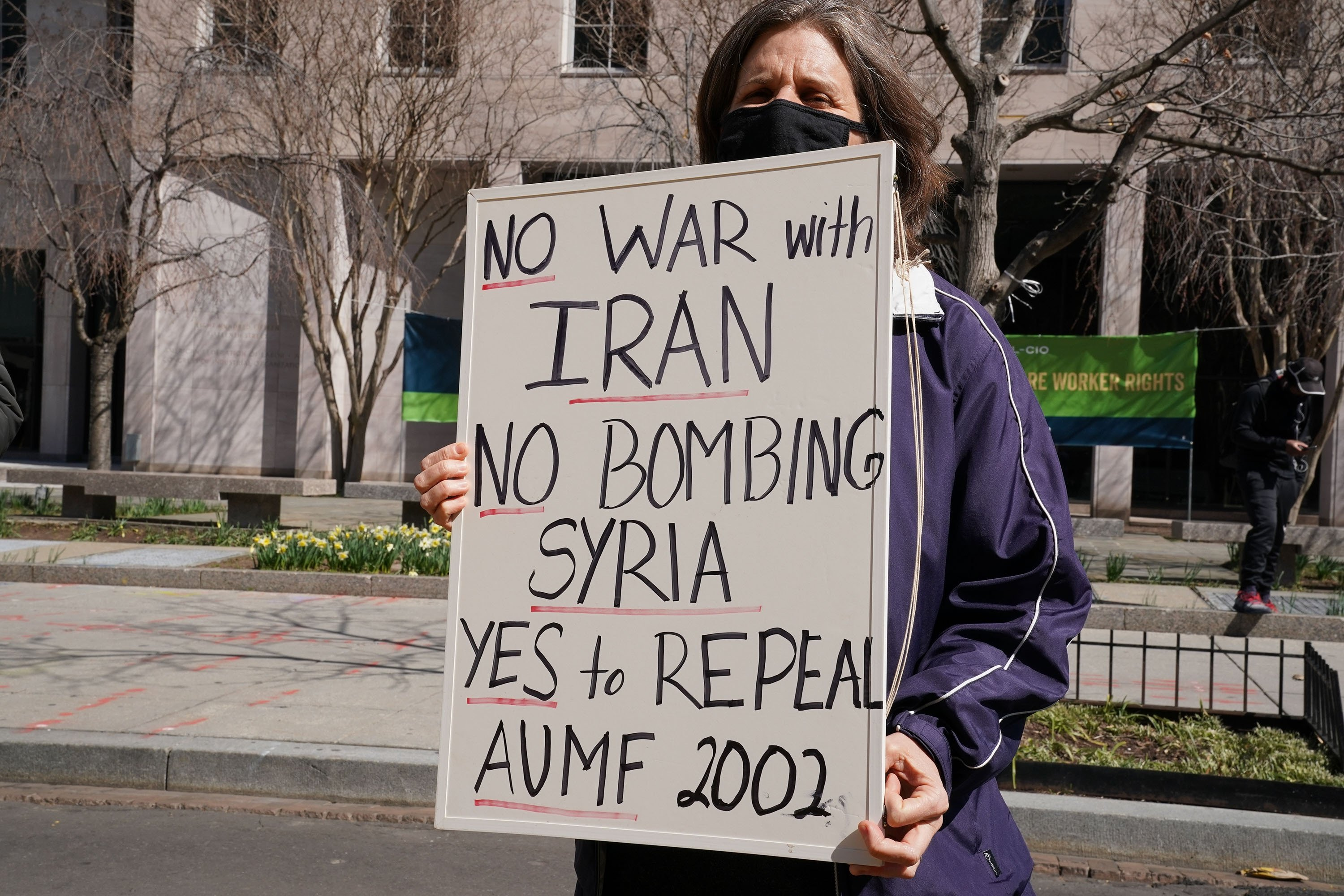 A demonstrator protests against any further aggression against Iran and Syria by asking the Biden administration to repeal the AUMF, in Washington D.C., U.S., Feb. 23, 2021. (Shutterstock Photo)