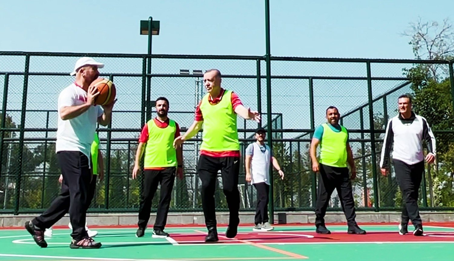 In this video screengrab President Recep Tayyip Erdoğan (C) plays basketball with several ministers and government officials at the Presidential Complex in Ankara, Turkey, Oct. 3, 2021.