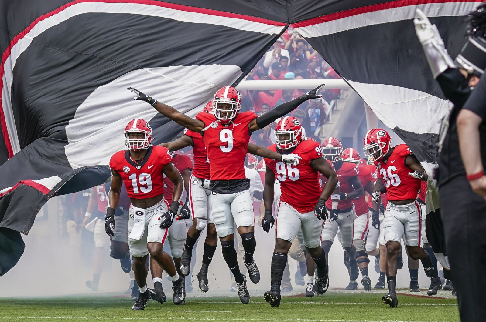 The Georgia Bulldogs led by defensive back Ameer Speed (9) run out to the field to face the Arkansas Razorbacks at Sanford Stadium, Athens, Georgia, U.S., Oct. 2, 2021. (Dale Zanine-USA TODAY Sports via Reuters)