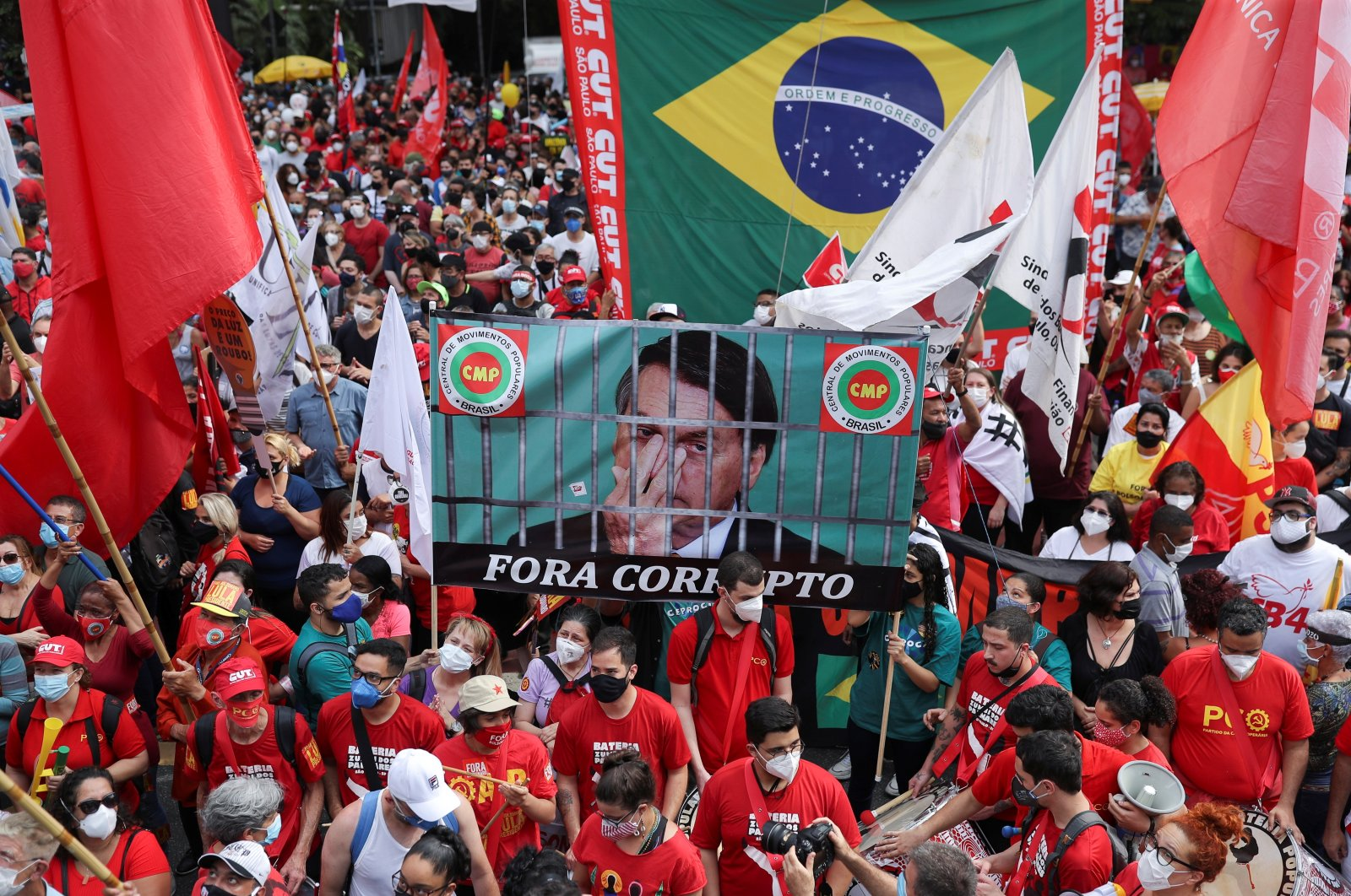 """Demonstrators protest against far-right President Jair Bolsonaro's administration with the image of Bolsonaro that reads: """"Out corrupt,"""" in Sao Paulo, Brazil, Oct. 2, 2021. (Reuters Photo)"""