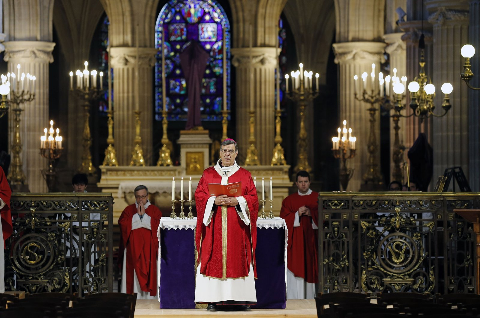 """Archbishop of Paris Michel Aupetit conducts Palm Sunday mass behind closed doors and inside an empty church at """"Saint-Germain-l'Auxerrois"""" during the early days of the COVID-19 pandemic, Paris, France,  April 5, 2020. (Getty Images)"""