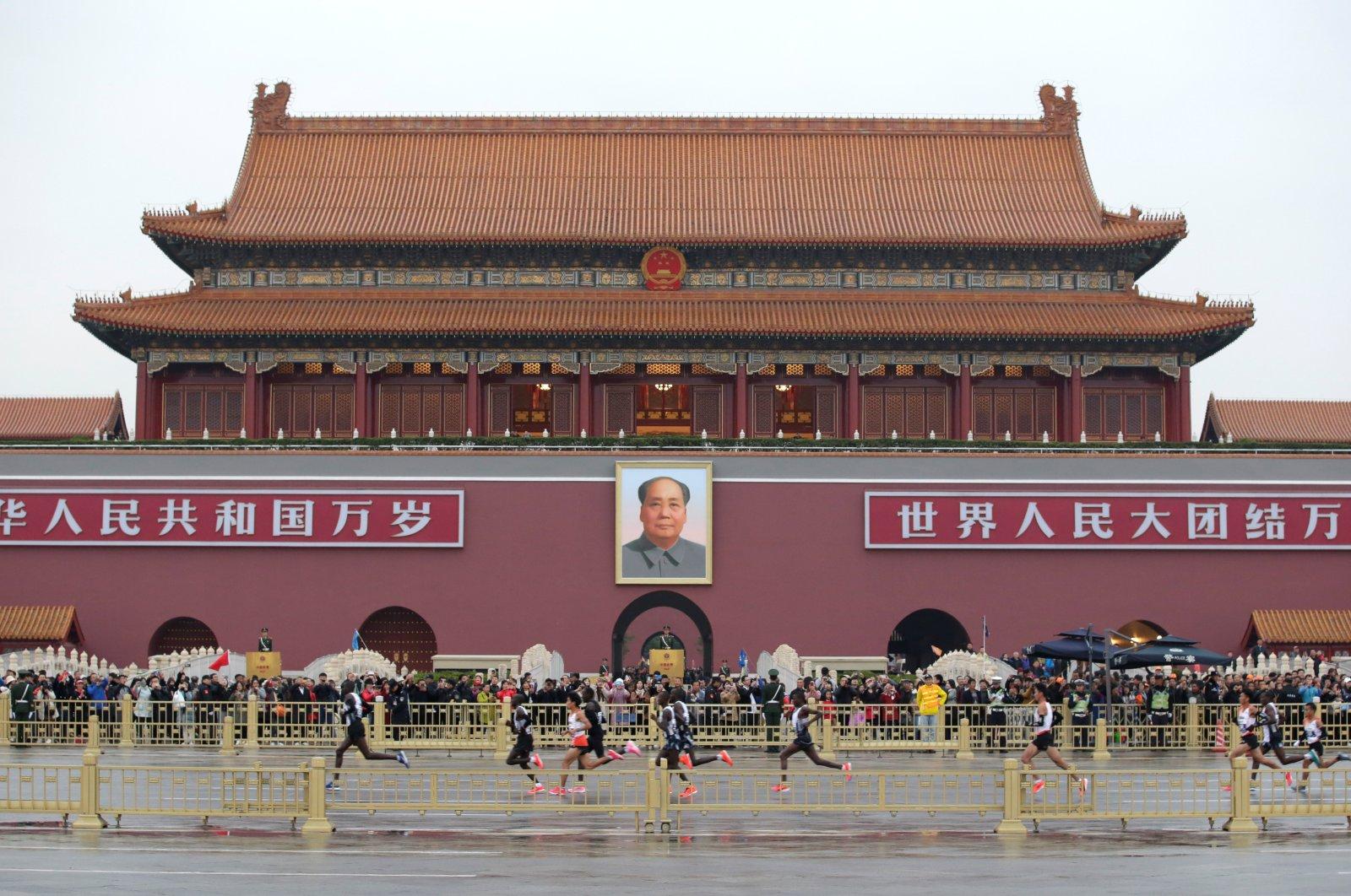 Leading athletes run past Tiananmen Gate during the annual Beijing Marathon in Beijing, China, Nov. 3, 2019. (Reuters Photo)