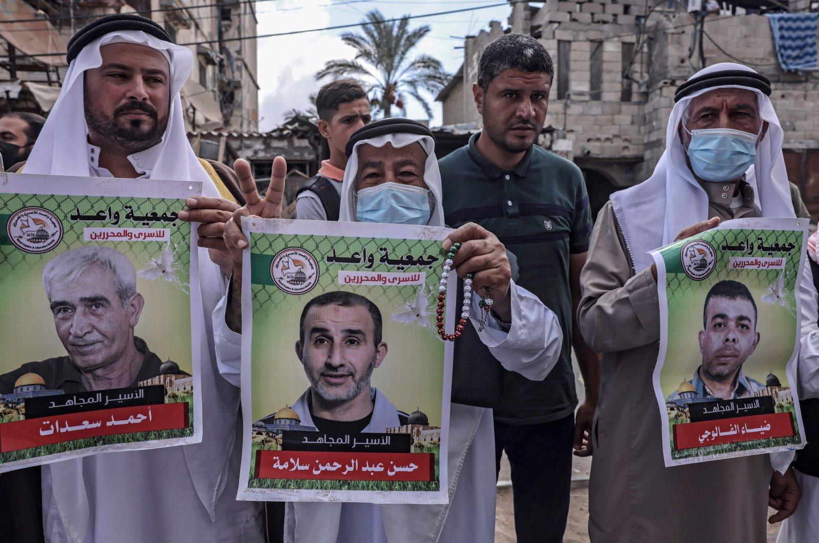Men march in solidarity with Palestinian prisoners in Israeli jails, in Khan Yunis, Gaza Strip, Palestine, Sept. 27, 2021. (AFP Photo)