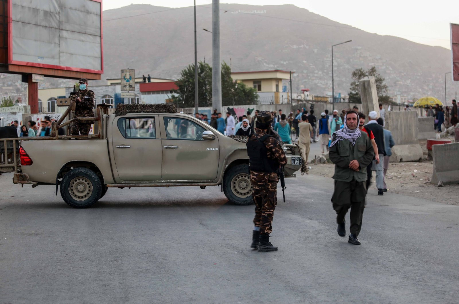 Taliban stand guard near the scene of a bomb blast in Kabul, Afghanistan, Oct. 3, 2021. (EPA Photo)