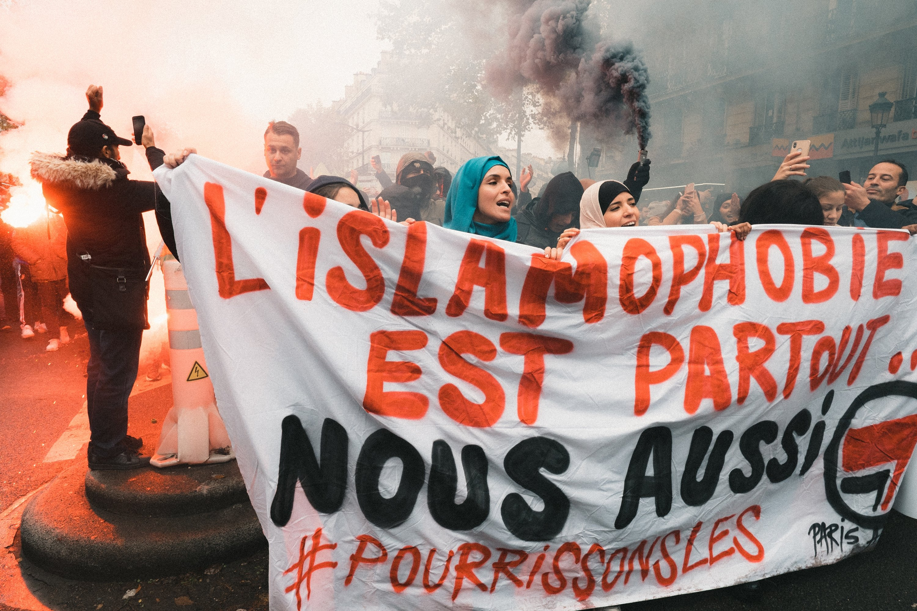 People chant slogans and hold placards as they take part in a demonstration march in front of the Gare du Nord, in Paris, France, Nov. 10, 2019, to protest against Islamophobia, at the call of several anti-racist activists and collectives. (Getty Images Photo)