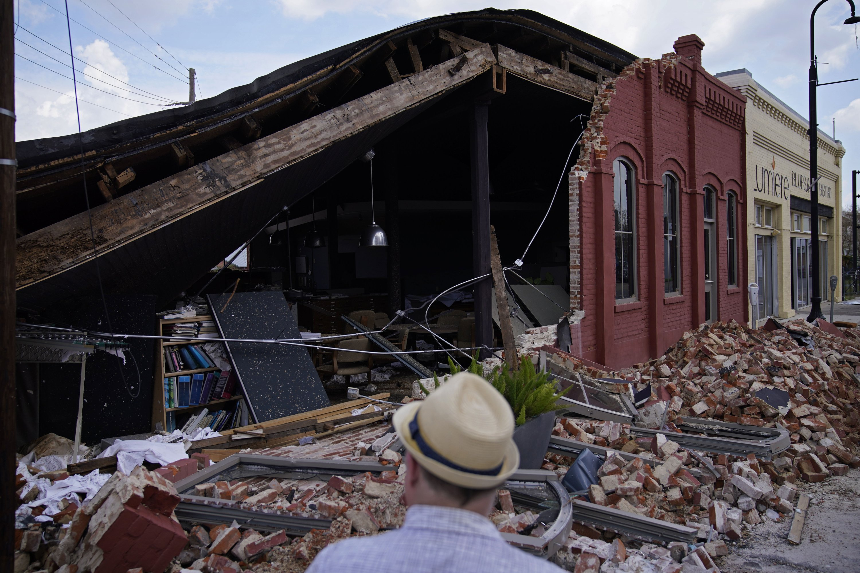 A man looks at a partially collapsed building in the aftermath of Hurricane Ida, Sept. 4, 2021, in Houma, Lousiana, U.S. (AP Photo)
