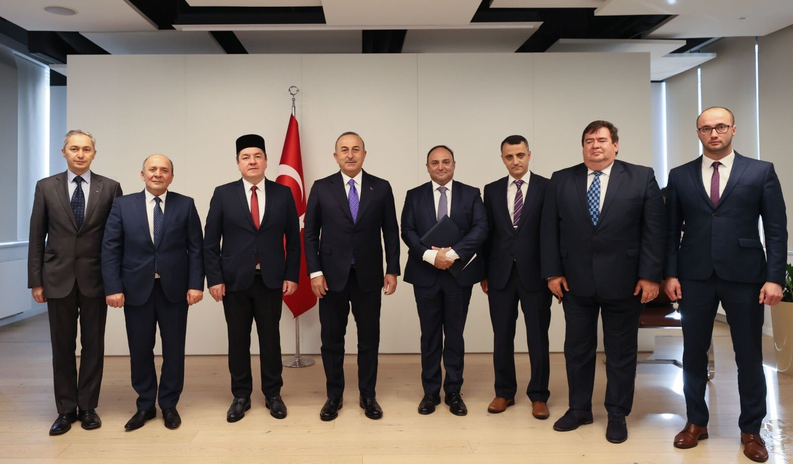 Foreign Minister Mevlüt Çavuşoğlu (C) meets with members of the Muslim Religious Union in Poland, Warsaw, Poland, Oct. 4, 2021. (AA Photo)