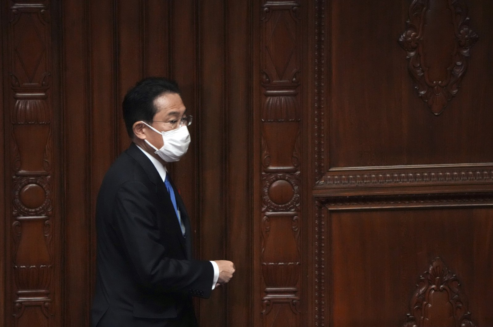 Fumio Kishida walks for voting at the parliament's lower house Monday, Oct. 4, 2021, in Tokyo. (AP Photo)