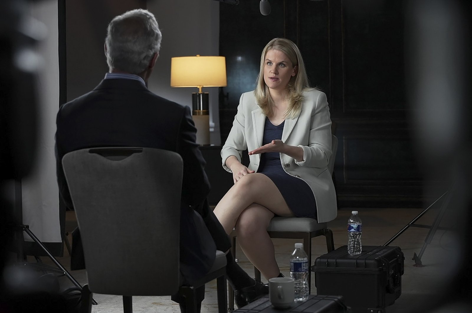 """In this Sept. 16, 2021, photo provided by CBS, Facebook whistleblower Frances Haugen talks with CBS' Scott Pelley on """"60 Minutes,"""" in an episode that aired on Oct. 3, 2021. (CBS News/60 Minutes via AP)"""