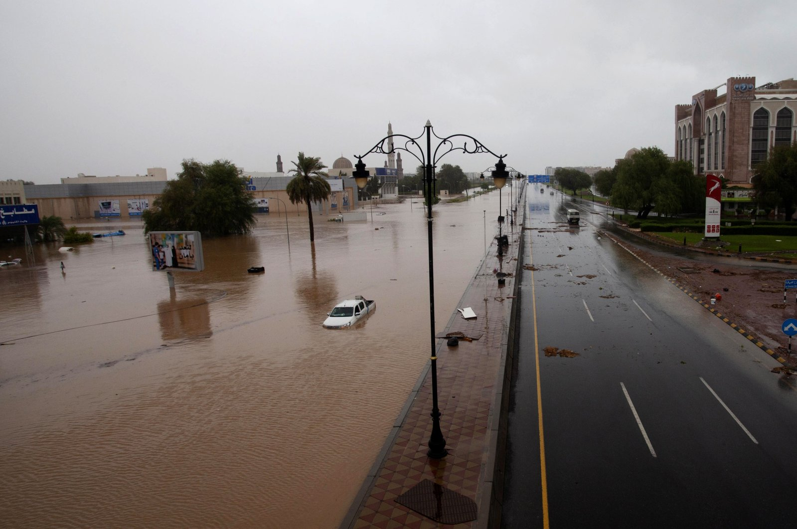 Cars are seen in flooded streets after Cyclone Shaheen hits the capital Muscat in Oman, Oct. 3, 2021. (EPA-EFE Photo)