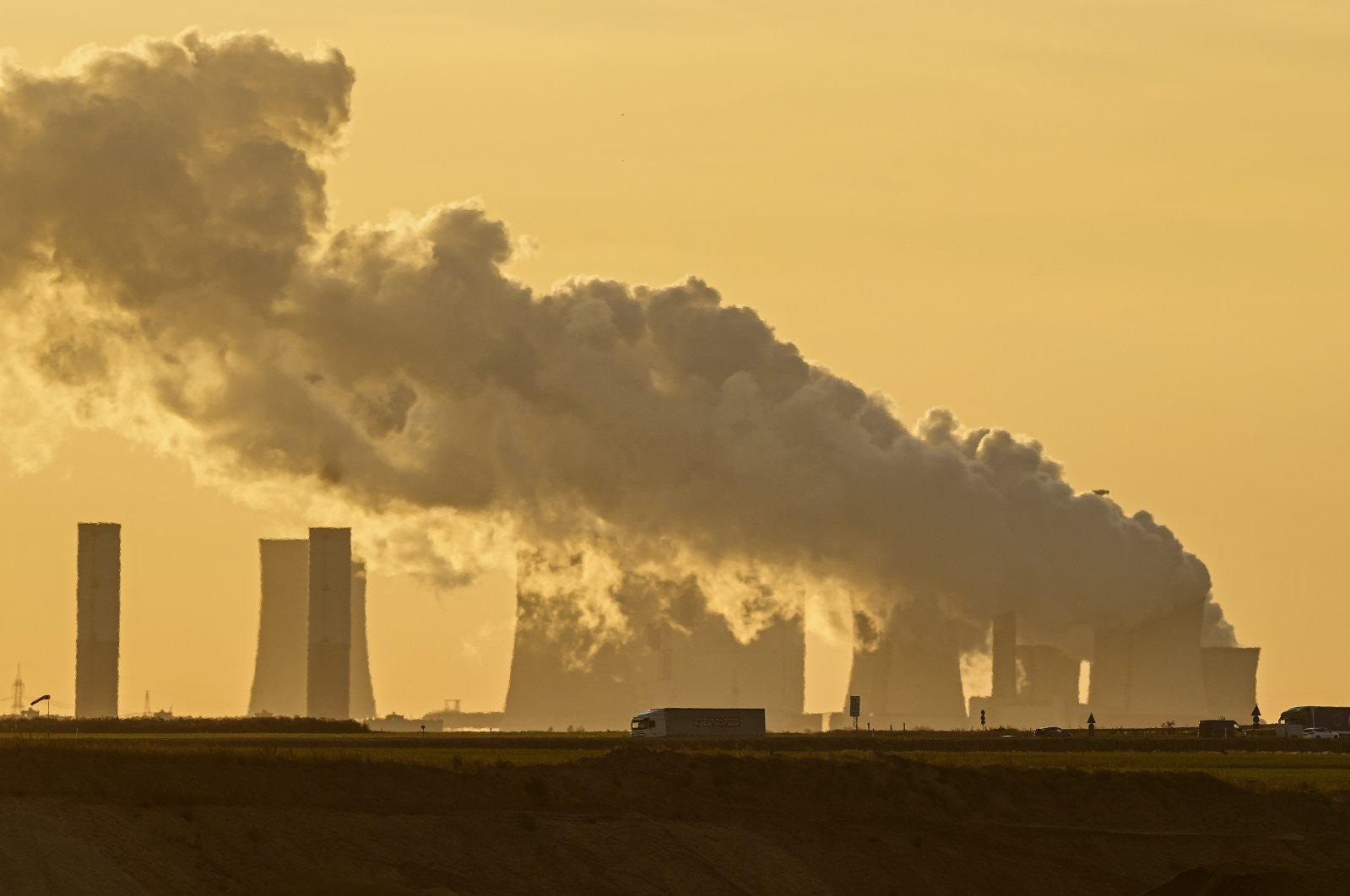 A power plant fires coal from the nearby Garzweiler open-cast mine near Luetzerath, western Germany, Oct. 1, 2021. (AP Photo)