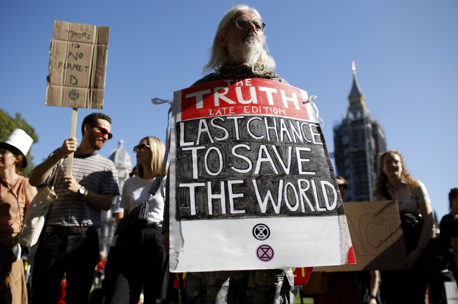 """Activists take part in a """"climate strike"""" demonstration, part of the global """"Fridays for Future"""" movement led by Swedish teenage environmentalist Greta Thunberg, in Parliament Square in London, Britain, Sept. 24, 2021. (AP Photo)"""
