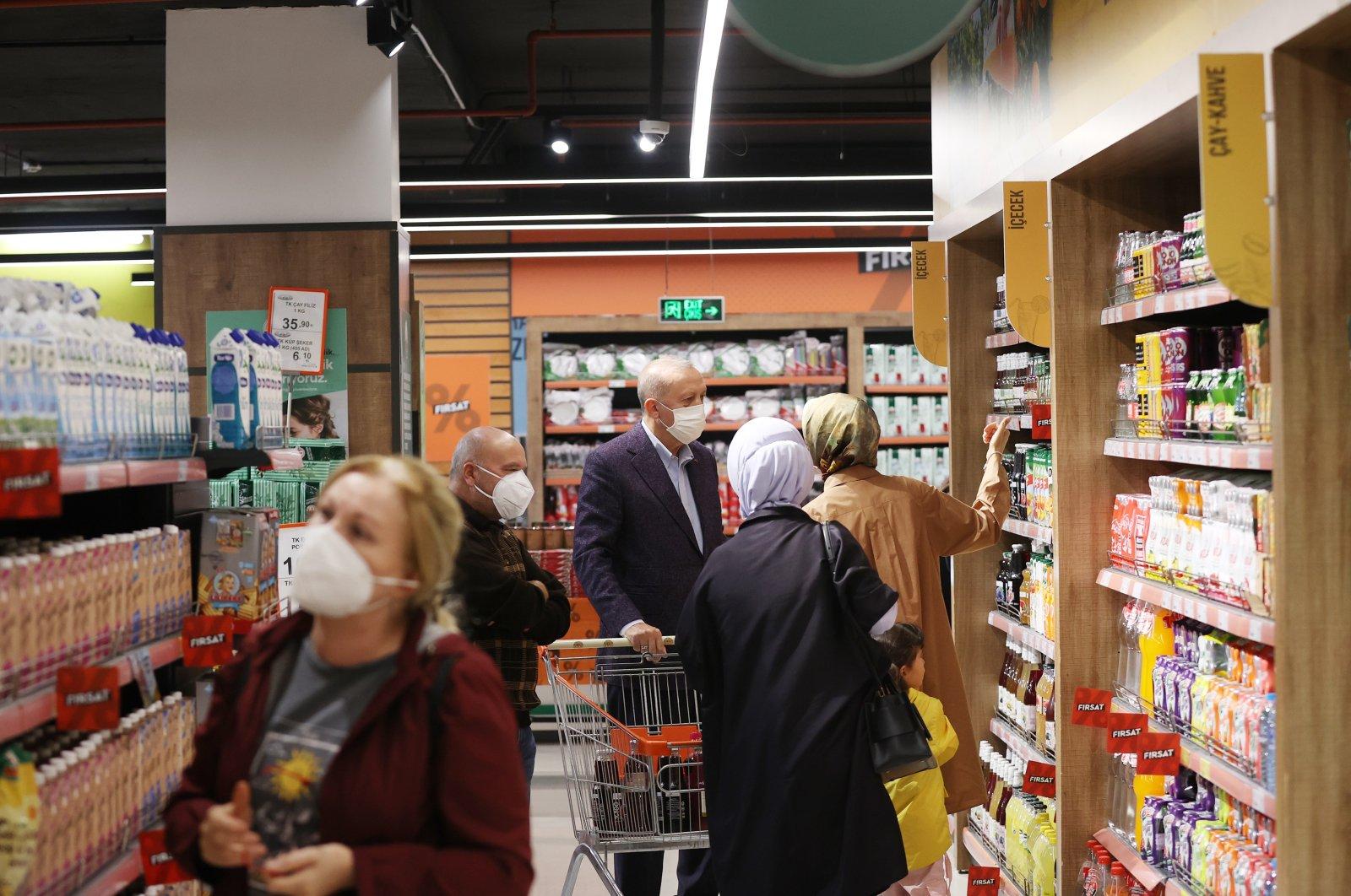President Recep Tayyip Erdoğan (C) and First Lady Emine Erdoğan shop at an agricultural credit cooperative outlet in theKısıklıneighborhood in Istanbul's Üsküdar district, Turkey, Oct. 4, 2021.
