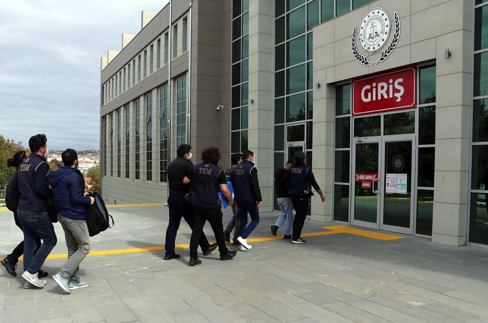 Police escort FETÖ suspects to court in Tekirdağ, northwestern Turkey, Oct. 1, 2021. The terrorist group's members are increasingly trying to flee abroad or have gone into hiding after FETÖ's 2016 coup attempt was quelled. (DHA Photo)