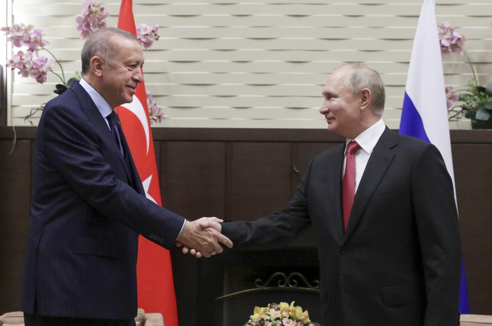 President Recep Tayyip Erdoğan (L) and Russian President Vladimir Putin shake hands during their meeting in the Bocharov Ruchei residence in the Black Sea resort of Sochi, Russia, Sept. 29, 2021. (AP Photo)
