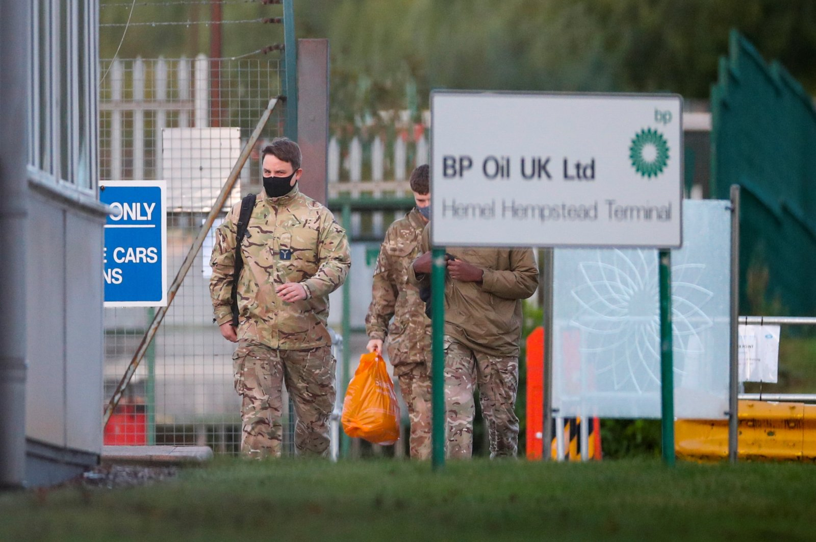 Members of the military walk at Buncefield Oil Depot in Hemel Hempstead, Britain, Oct. 4, 2021. (Reuters Photo)