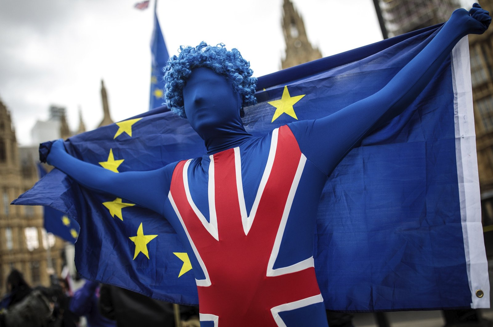 An anti-Brexit campaigner demonstrates outside the Houses of Parliament with EU flags as MPs return following the Easter break in London, England, April 16, 2018. (Getty Images)