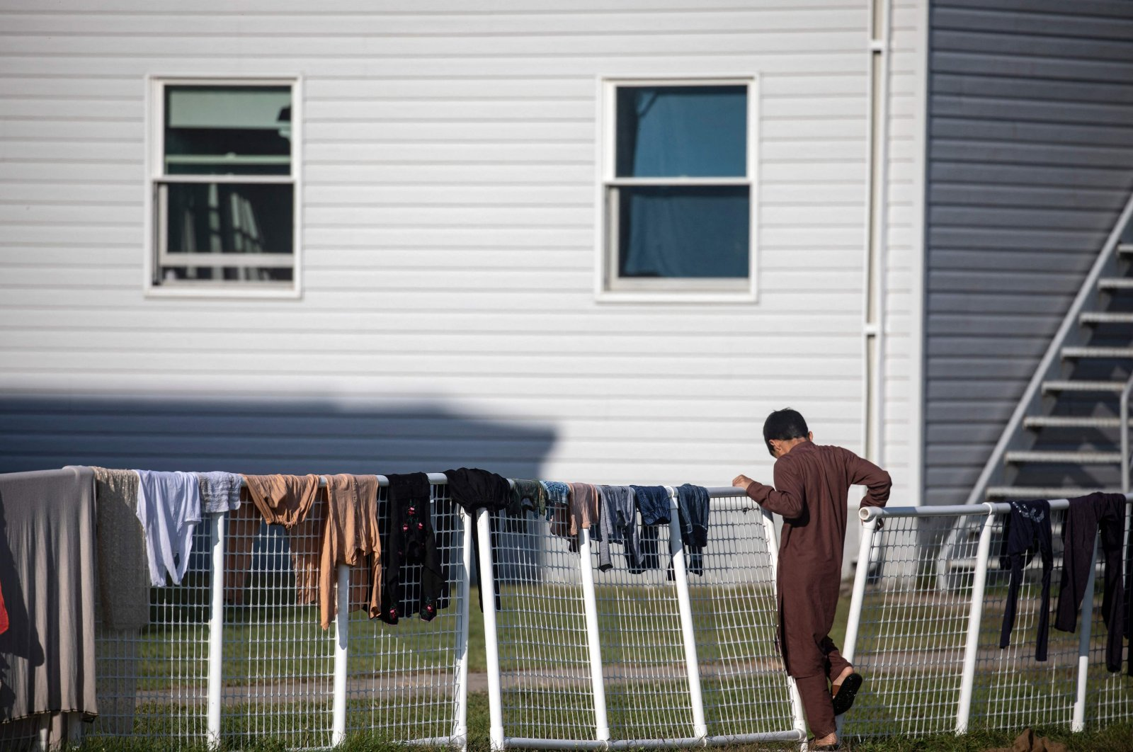 An Afghan refugee stands outside temporary housing at Ft. McCoy U.S. Army base, Sept. 30, 2021, Wisconsin, U.S. (AFP Photo)