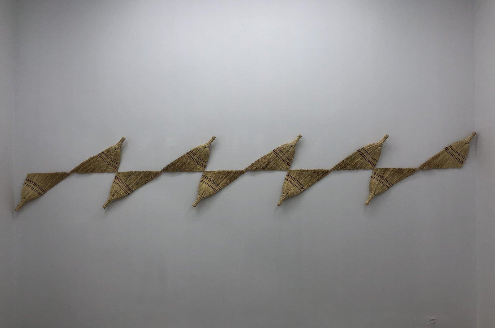 "Şakir Gökçebağ's work creating a veritable optical illusion of brooms in ""Redimeyd"" at Ferda Art Platform in Istanbul, Turkey. (Courtesy of Şakir Gökçebağ)"