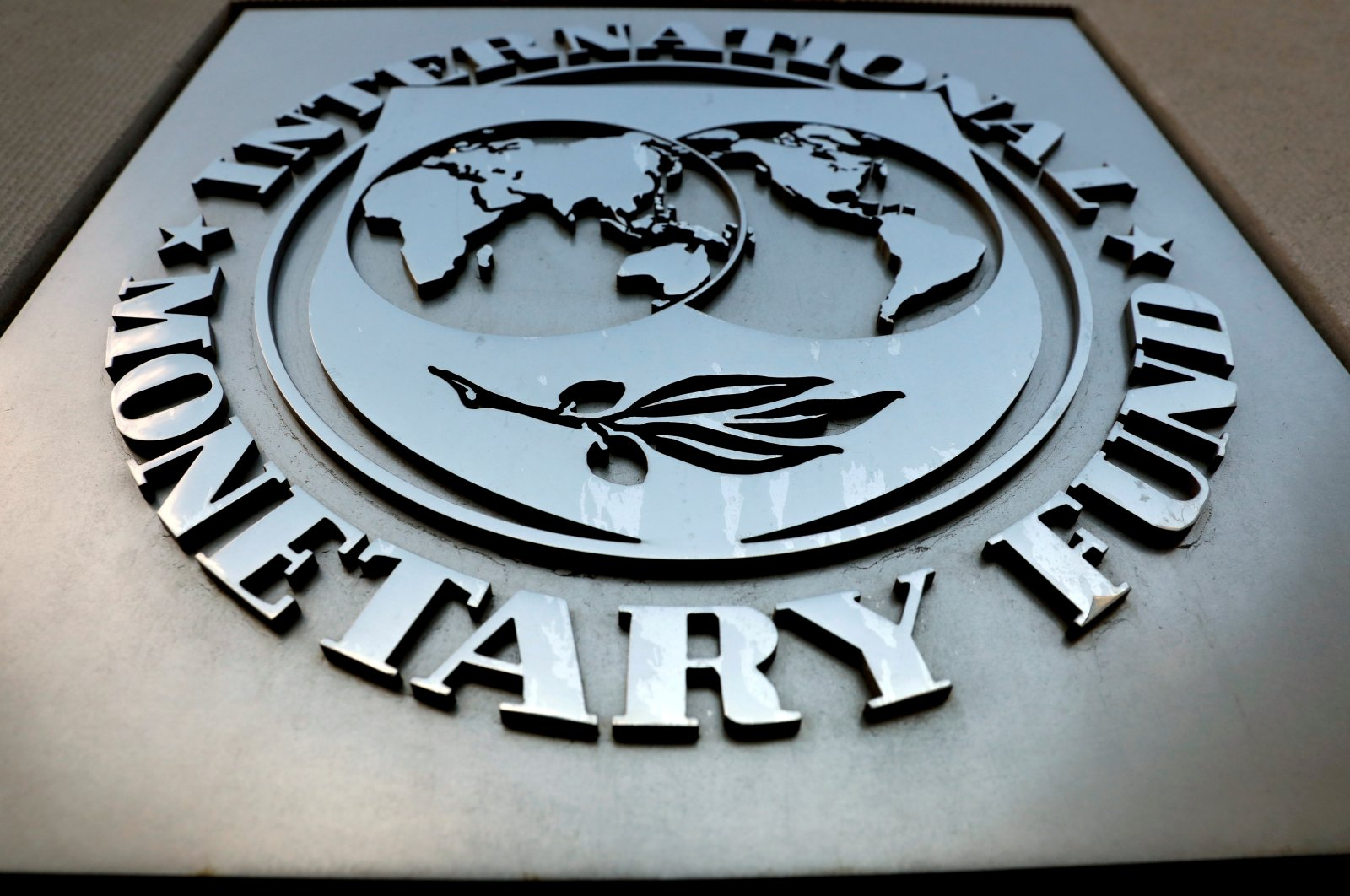The International Monetary Fund (IMF) logo is seen outside the headquarters building in Washington, U.S., Sept. 4, 2018. (Reuters File Photo)