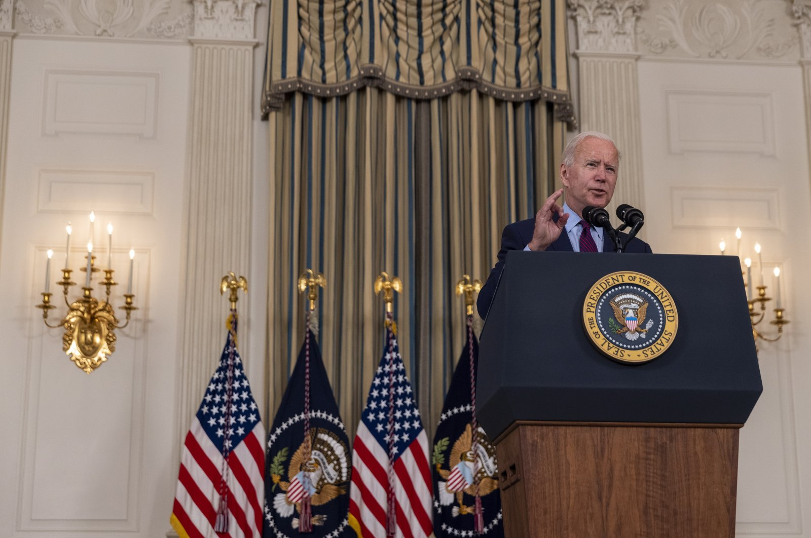 U.S. President Joe Biden delivers remarks in the state dining room at White House in Washington, D.C., U.S., Oct. 4, 2021. (EPA Photo)