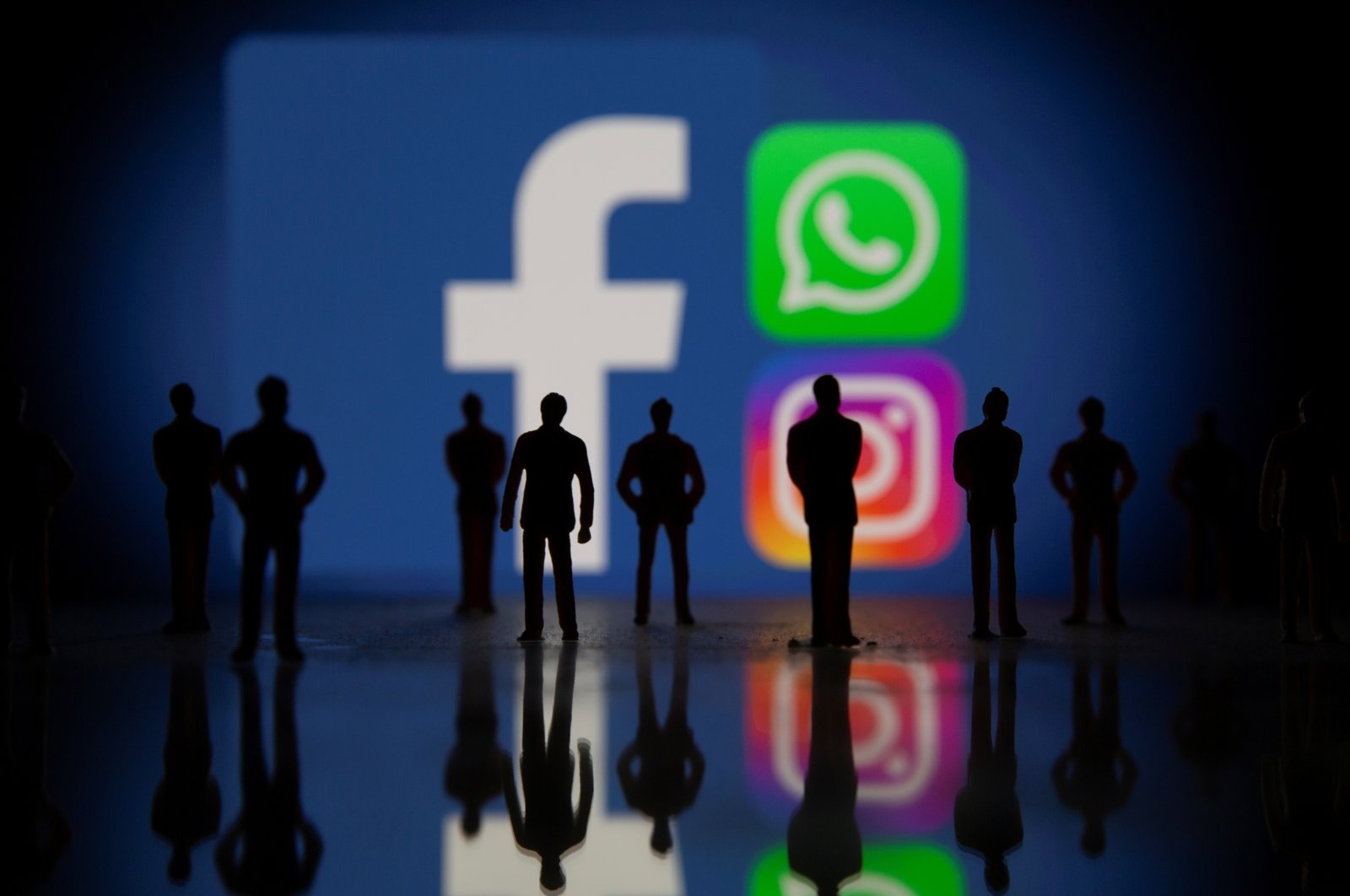 Small toy figures are seen in front of displayed Facebook, WhatsApp and Instagram logos in this illustration taken October 4, 2021. (Reuters Photo)
