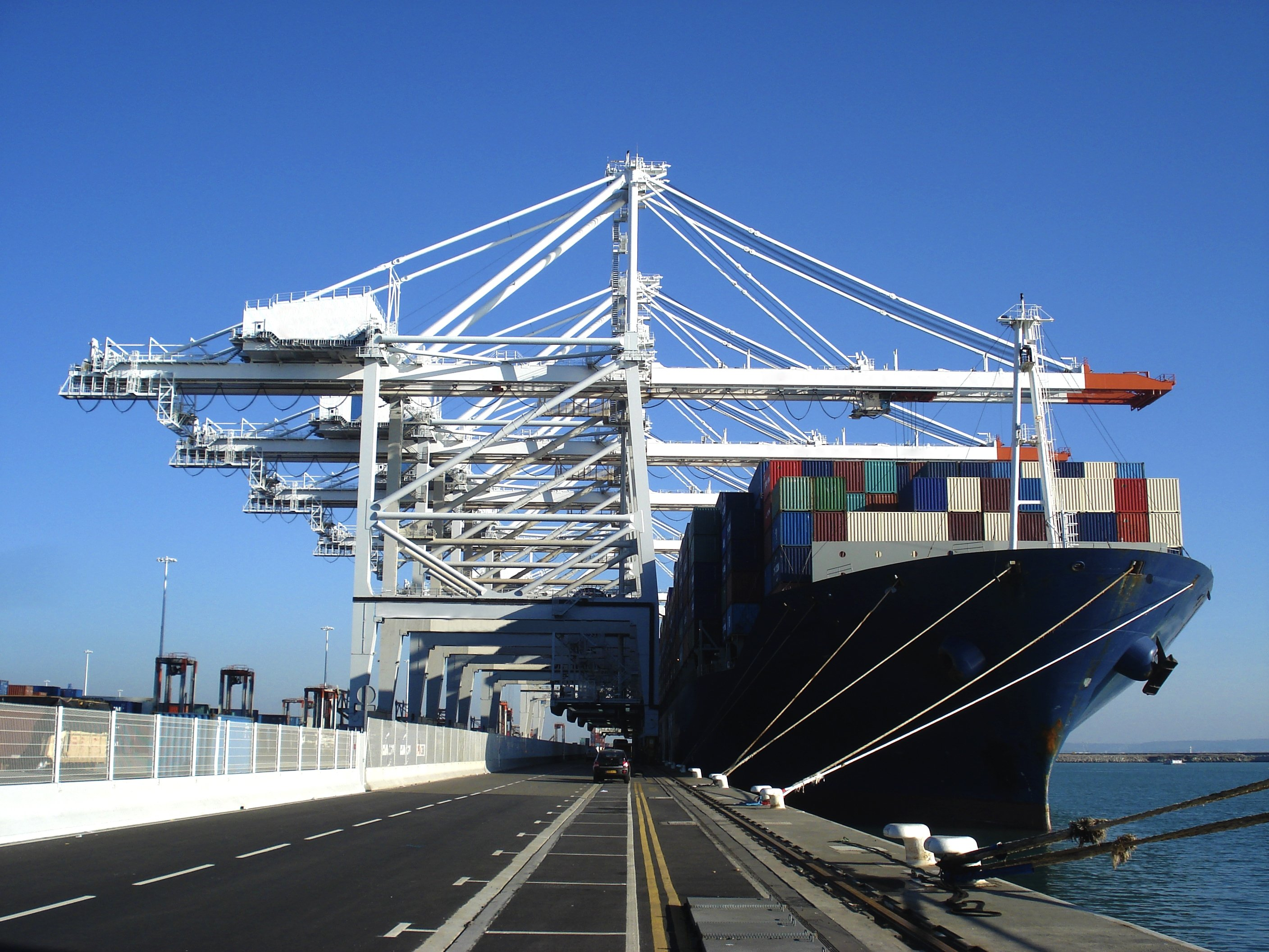 A huge cargo container ship at the commercial loading dock of Le Havre, the second-largest French port and the fifth-largest North European port. (Shutterstock Photo)