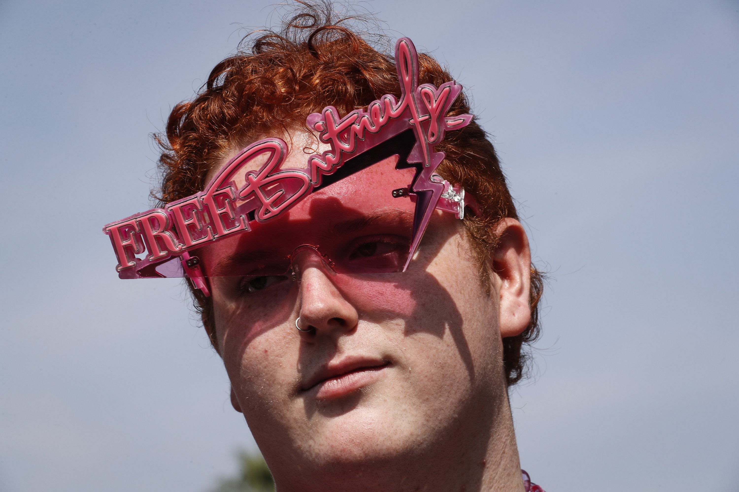 Alejandro Sanz wears sunglasses with 'Free Britney' written on top during a rally outside the Stanley Mosk Courthouse in Los Angeles, California, U.S., Sept. 29, 2021. (EPA Photo)