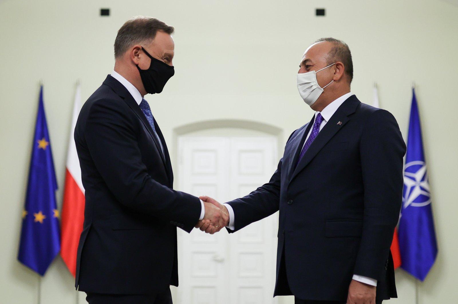 Poland's President Andrzej Duda receives Foreign Minister Mevlüt Çavuşoğlu in Warsaw, Poland, Oct. 4, 2021 (AA Photo)