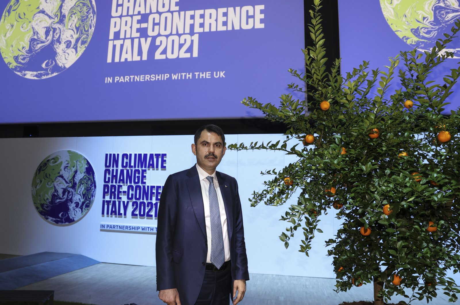 Environment and Urban Planning Minister Murat Kurum poses on the sidelines of a climate change summit, in Milan, Italy, Sept. 30, 2021. (AA PHOTO)