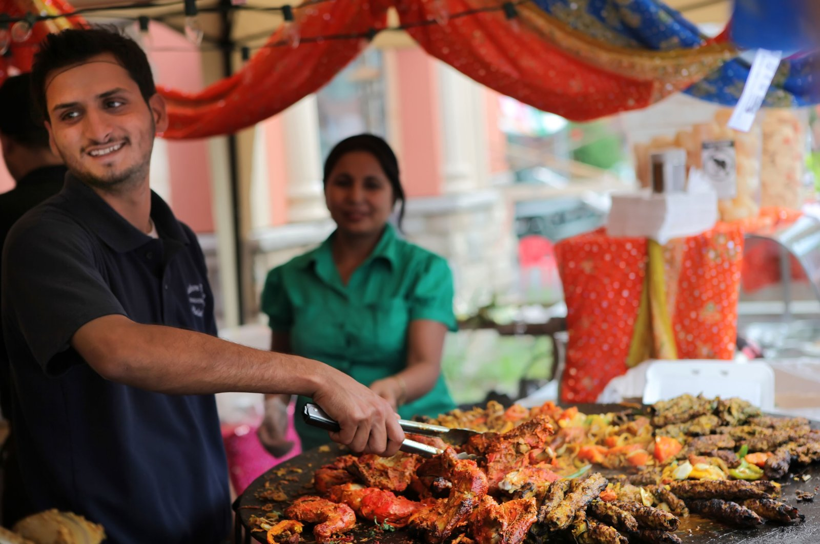 A Pakistani chef cooks kabobs and other Lahori delicacies on large kataks (hot plates) at a Pakistani Restaurant in Toronto, Ontario, Canada, on Aug. 23, 2009. (Getty Images)