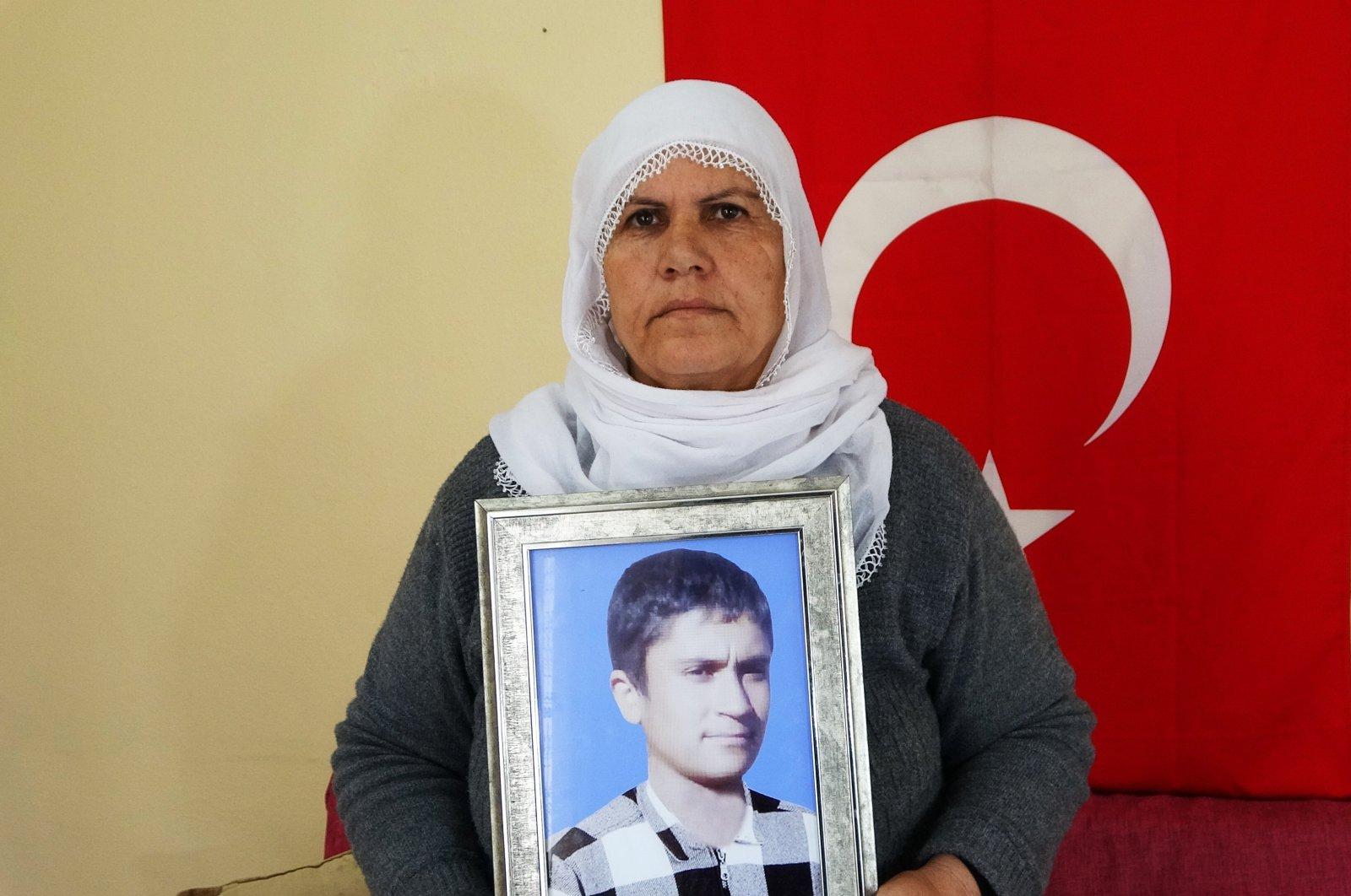 Naciye Sönmez Yıldız holds photo of her son abducted by the PKK in Muş, Turkey, Monday, Oct. 4, 2021. (IHA Photo)
