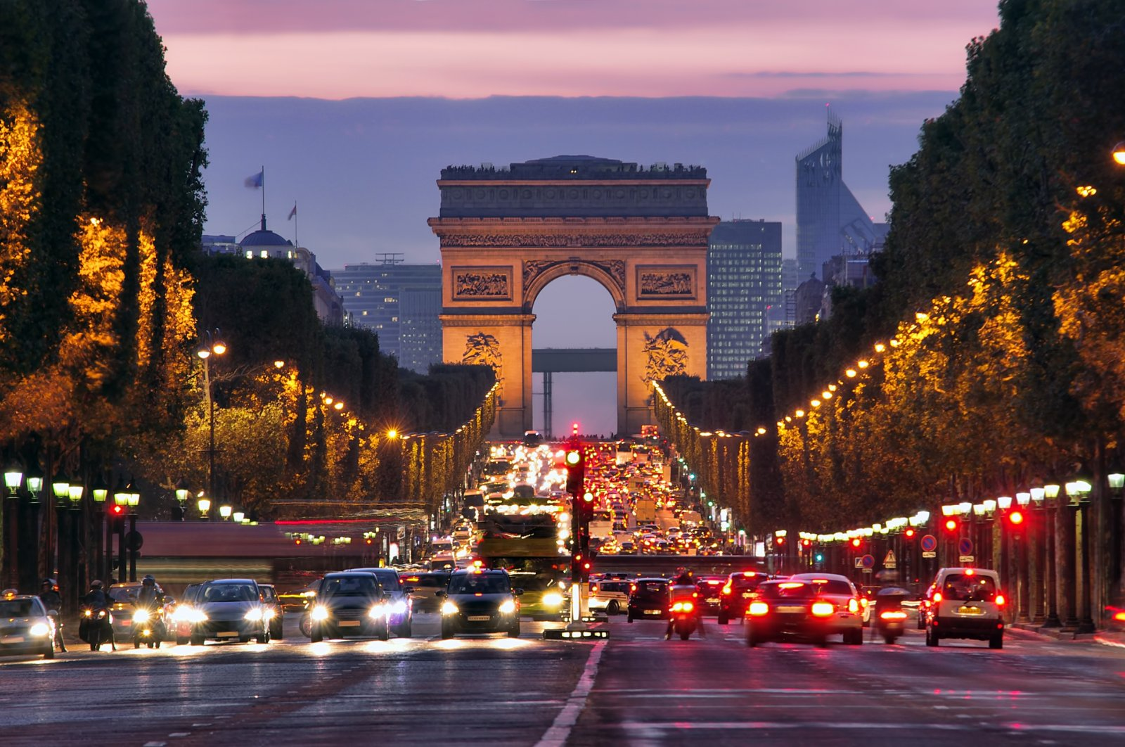 Champs-Elysees at night, Paris, France. (Shutterstock Photo)