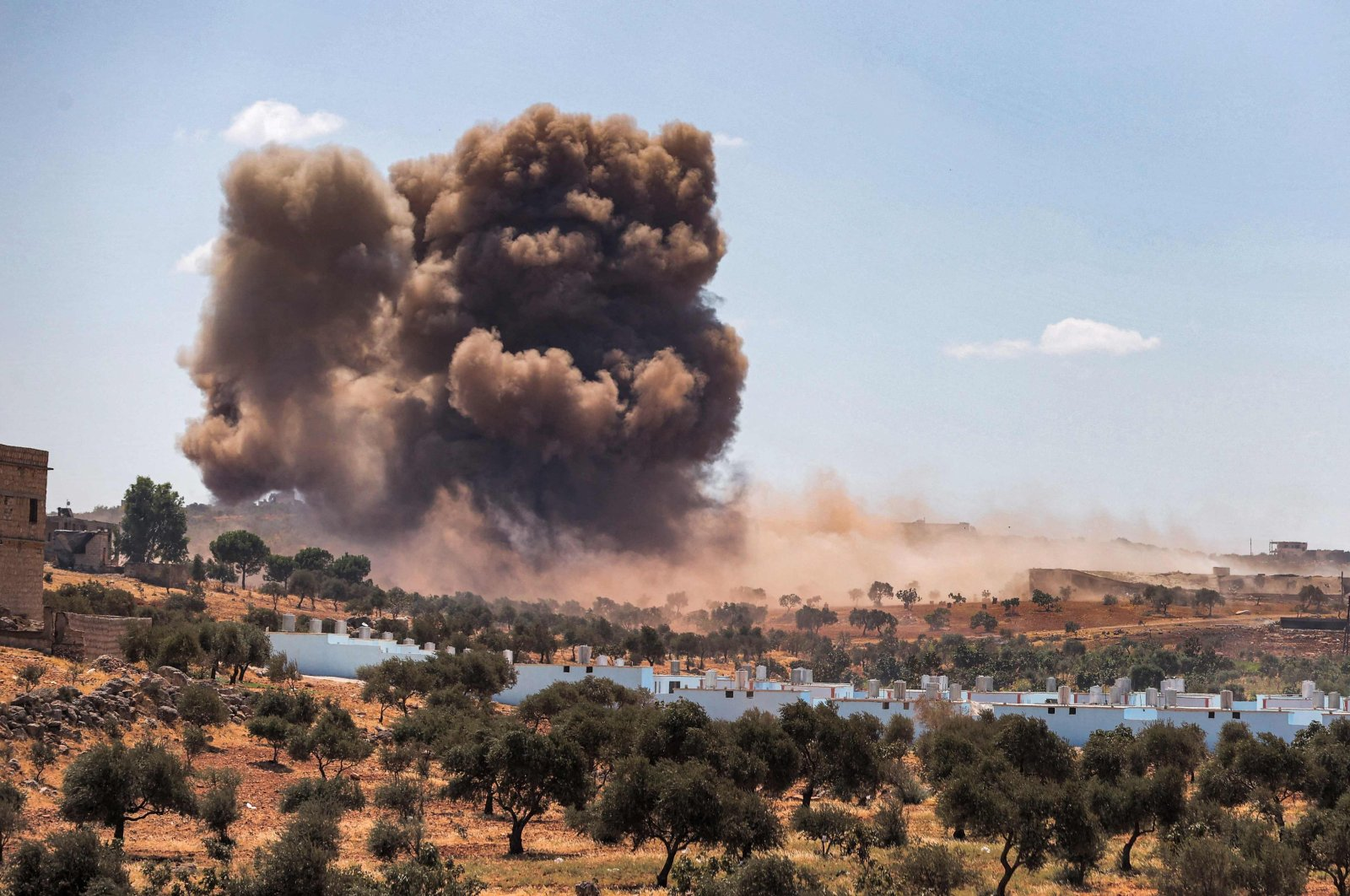 A smoke plume rising from aerial bombardment near a make-shift camp for displaced Syrians near the town of Kafraya in the north of Idlib province, northwestern Syria, Sept. 7, 2021. (AFP Photo)