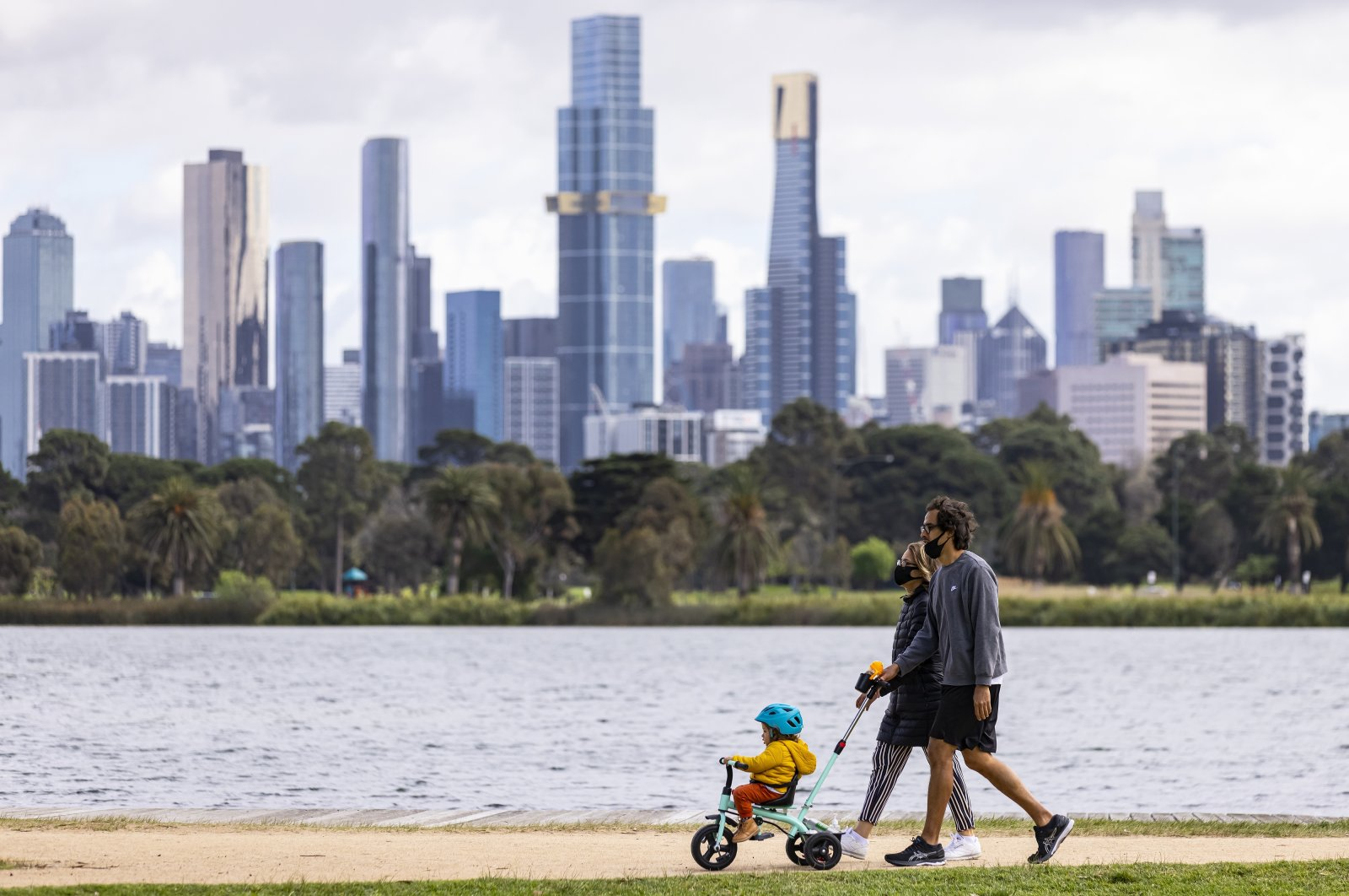 People exercise at Albert Park Lake in Melbourne, Victoria, Australia, Oct. 4, 2021. (EPA Photo)