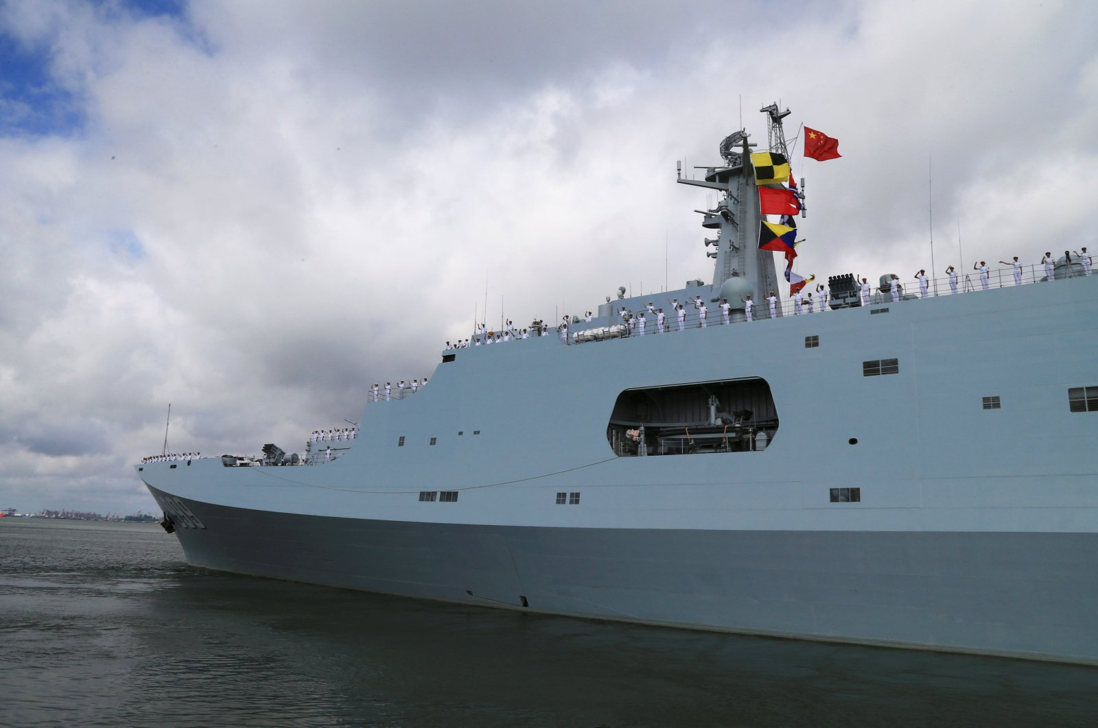 Soldiers of China's People's Liberation Army (PLA) salute from a ship sailing off from a military port in Zhanjiang, Guangdong province, China, July 11, 2017. (Reuters Photo)