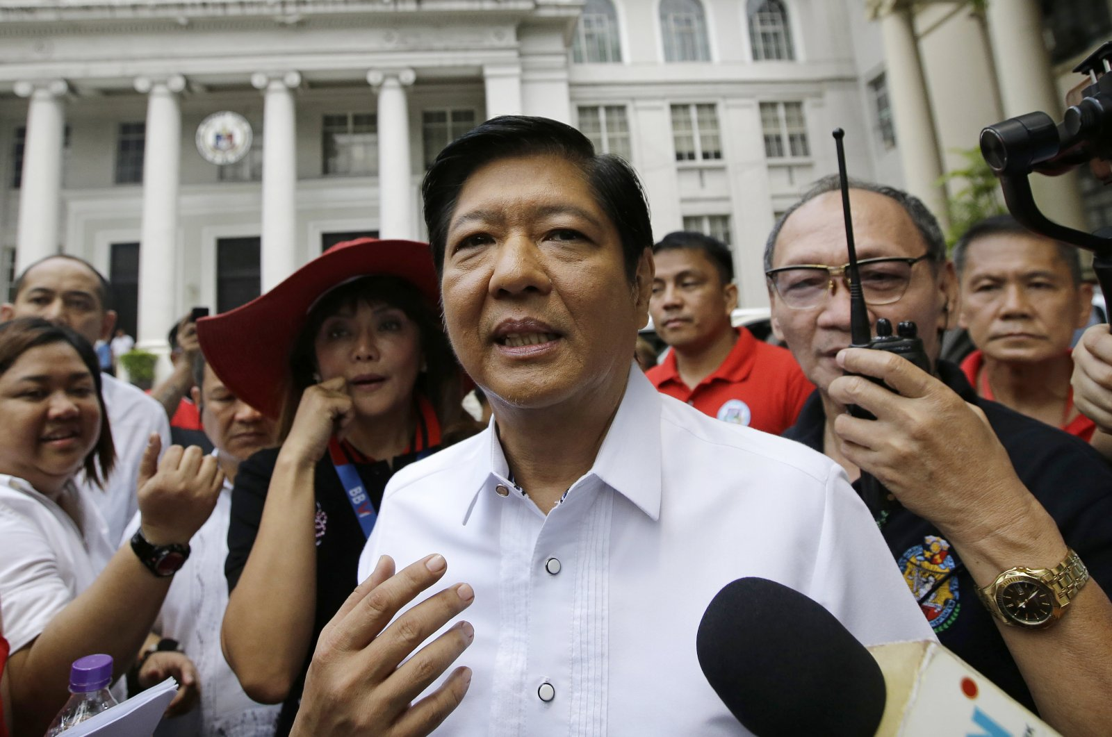 """Former Senator Ferdinand """"Bongbong"""" Marcos Jr. talks to reporters in front of the Philippine Supreme Court in Manila, Philippines, April 2, 2018. (AP Photo)"""