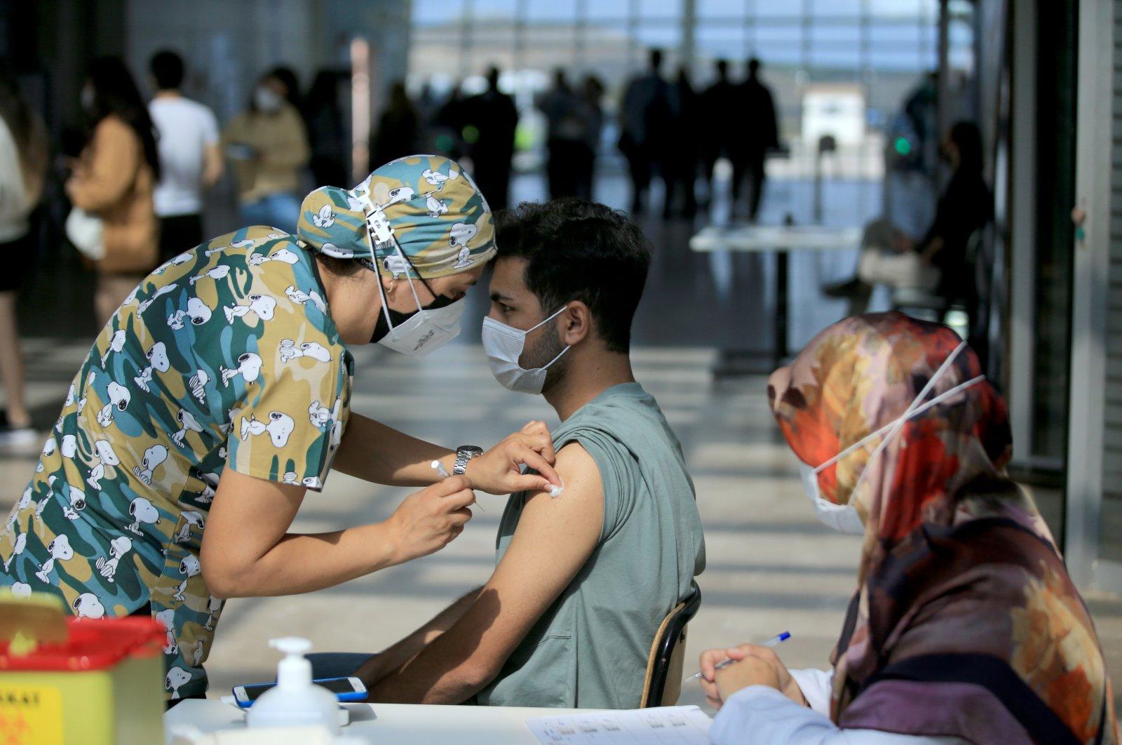 Barış Kaya, a student, gets vaccinated at a university campus in Kırklareli, northwestern Turkey, Oct. 5, 2021. (AA PHOTO)