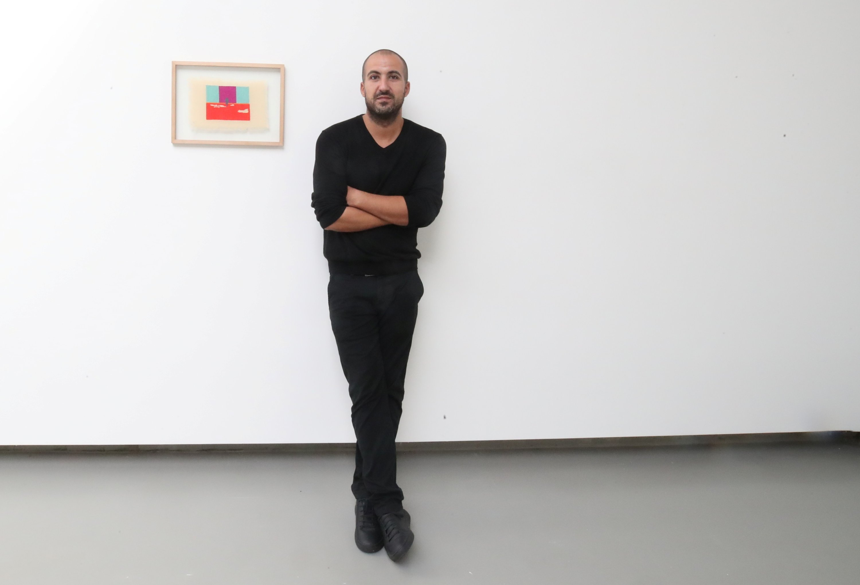"""Palestinian artist Majd Abdel Hamid poses for Reuters during his exhibition """"A Stitch in Times"""" in Brussels, Belgium Oct. 5, 2021. (Reuters Photo)"""