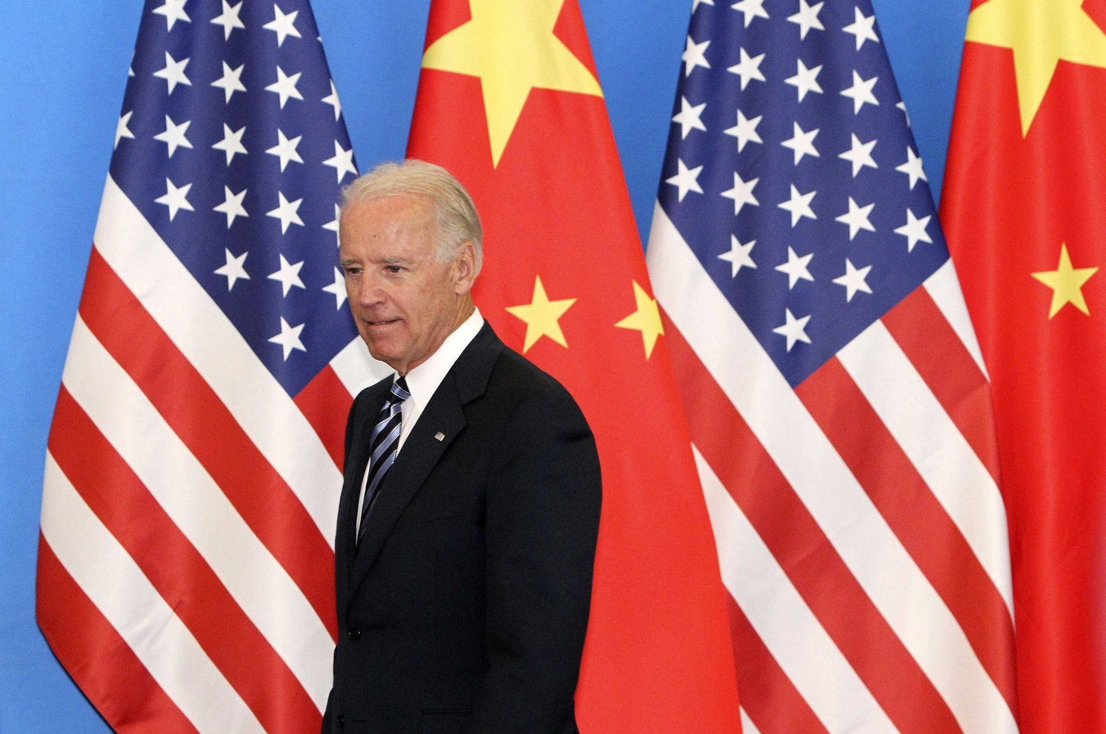 Then-U.S. Vice President Joe Biden arrives with his Chinese counterpart Xi Jinping (not pictured) at a China-U.S. Business Dialogue in Beijing, China, Aug. 19, 2011. (Reuters Photo)