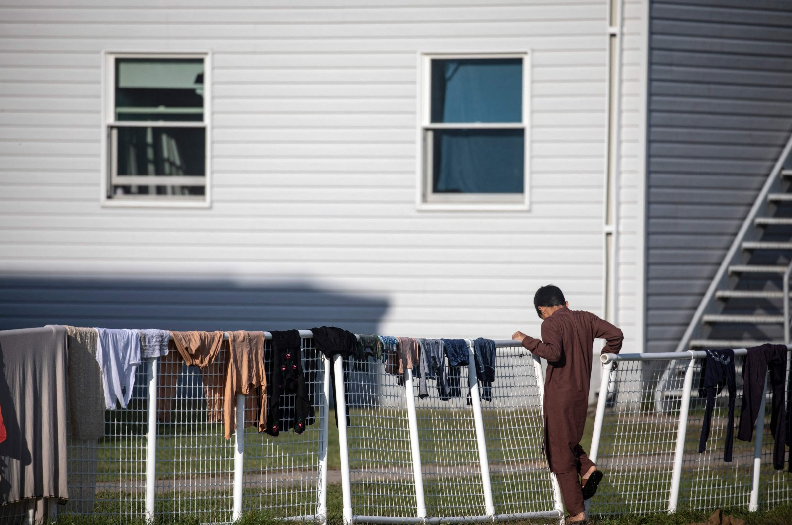An Afghan refugee stands outside temporary housing at Ft. McCoy U.S. Army base, Sept. 30, 2021 in Ft. McCoy, Wisconsin, U.S. (AFP Photo)
